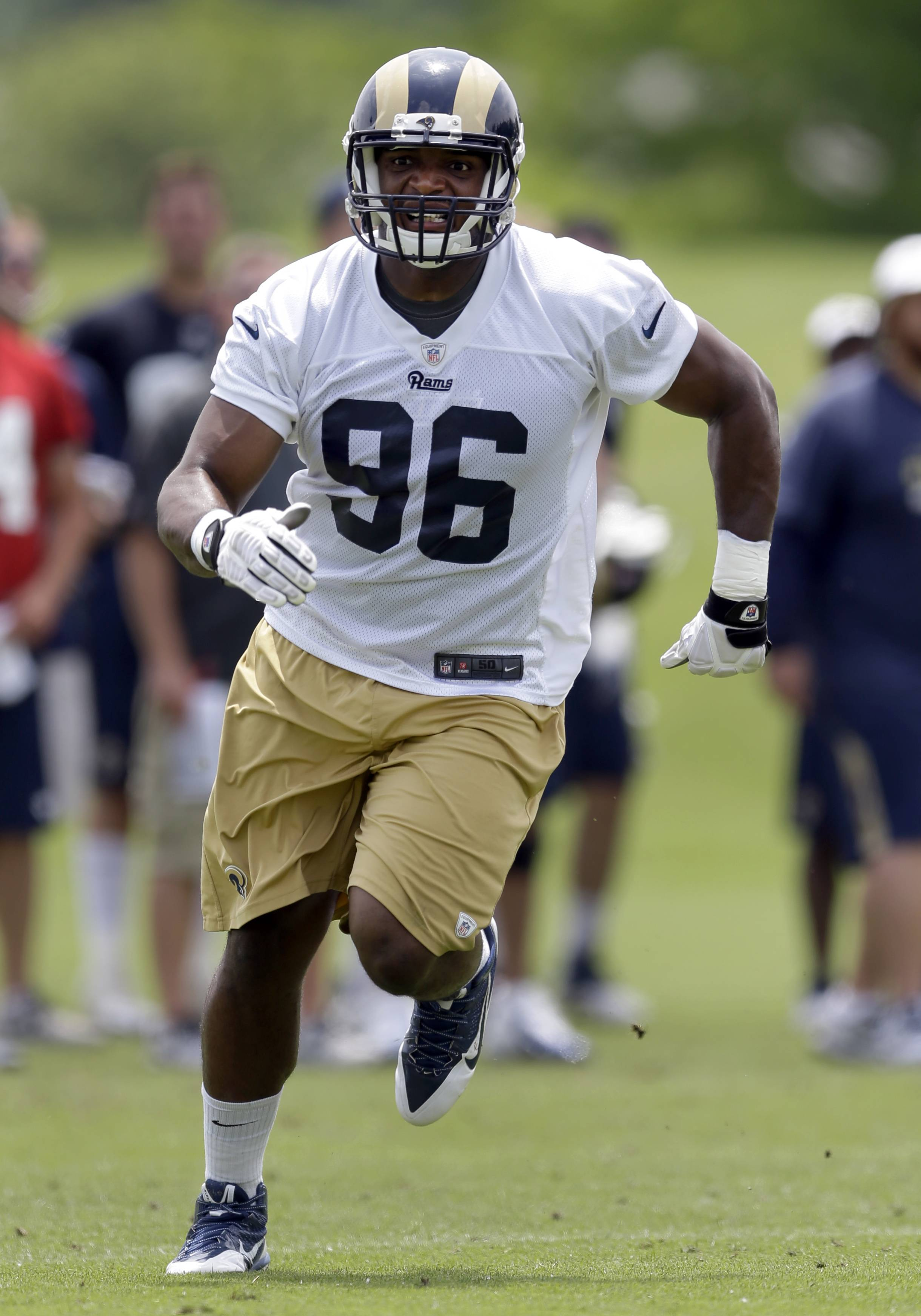 St. Louis Rams defensive end Michael Sam runs during an organized team activity at the NFL football team's practice facility Friday, June 6, 2014, in St. Louis.