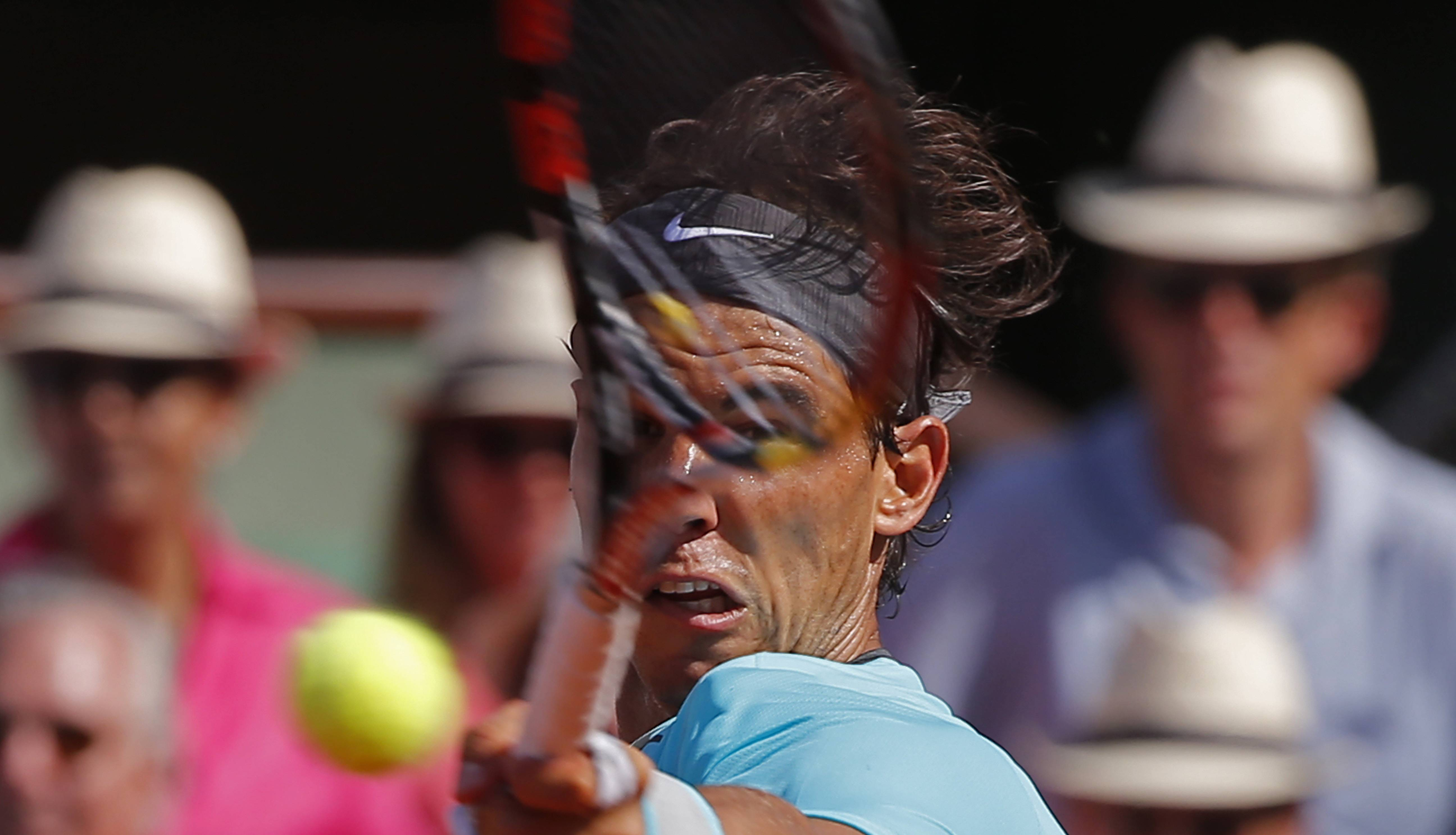 Spain's Rafael Nadal returns the ball during the semifinal match of the French Open tennis tournament against Britain's Andy Murray at the Roland Garros stadium, in Paris, France, Friday, June 6, 2014.