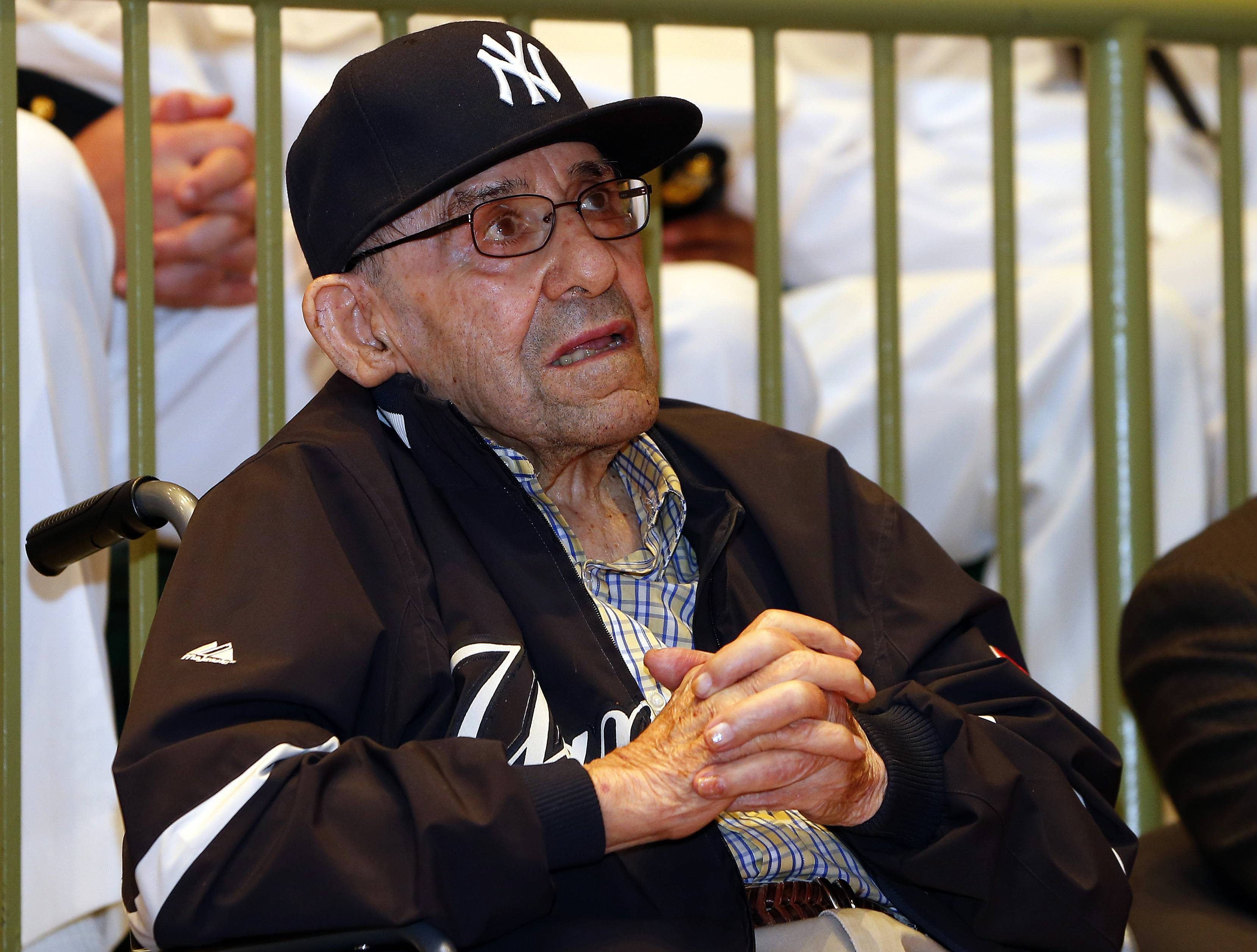 Baseball Hall of Famer Yogi Berra looks on as he is honored by the U.S. Navy for his service 70 years ago during the D-Day Invasion at a ceremony at the Yogi Berra Museum in Montclair, N.J., Friday, June 6, 2014.