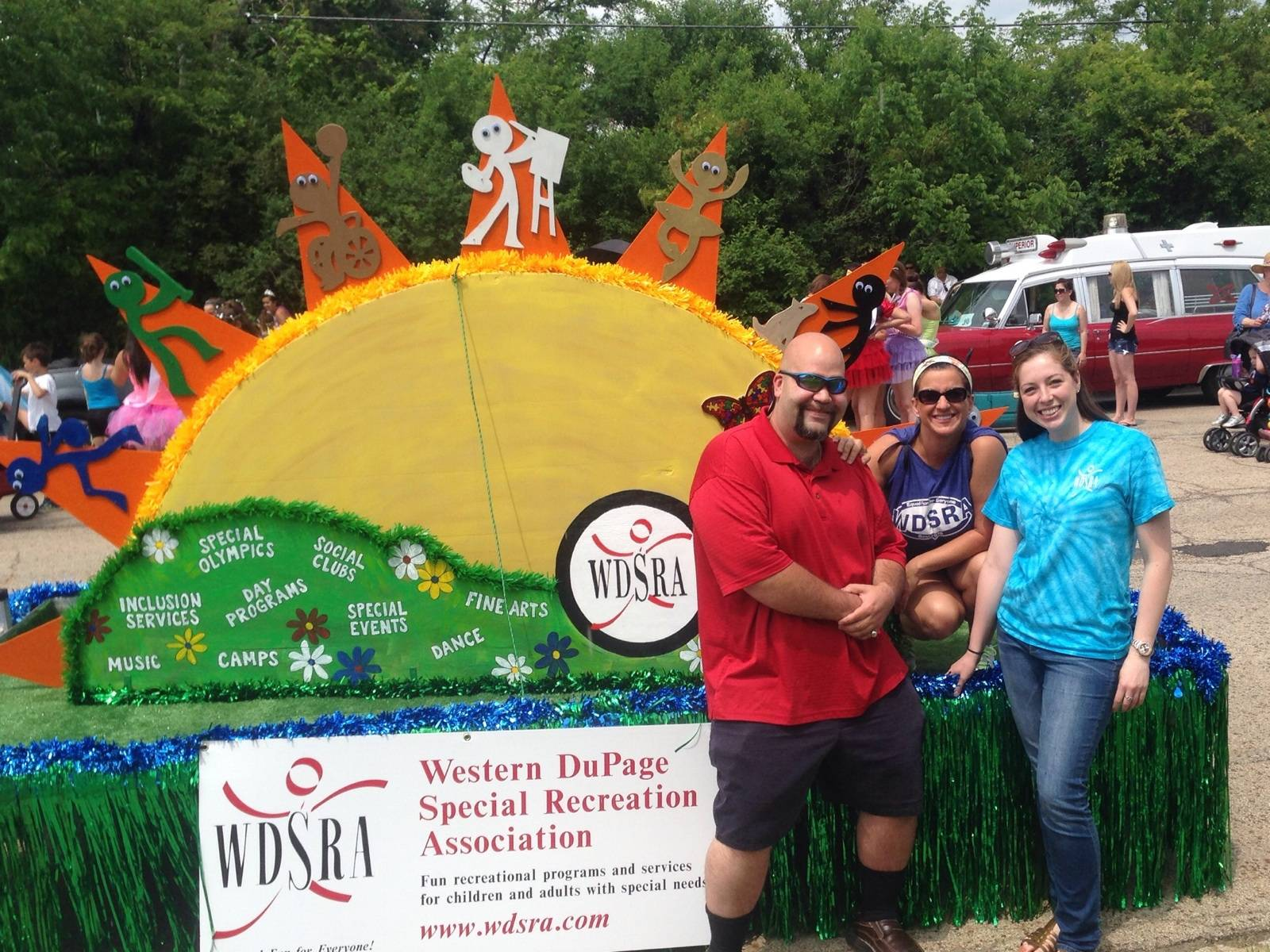 WDSRA staff and participant pose with the new parade float before the 2014 Rose Parade in Roselle, IL. Dori Napolitano