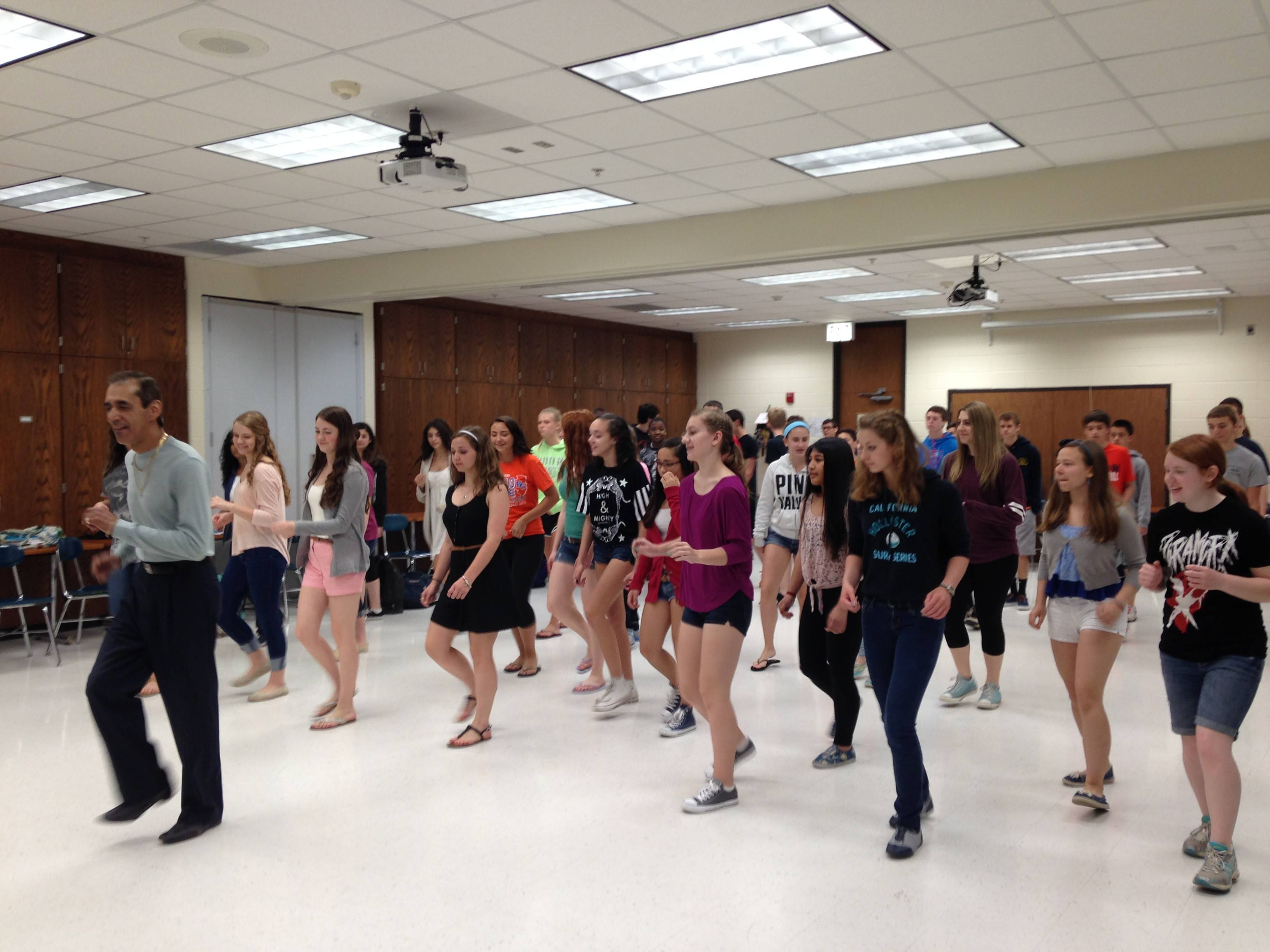 Buffalo Grove High School Spanish students learn Latin dances from Miguel Mendez of Salsa Chicago.