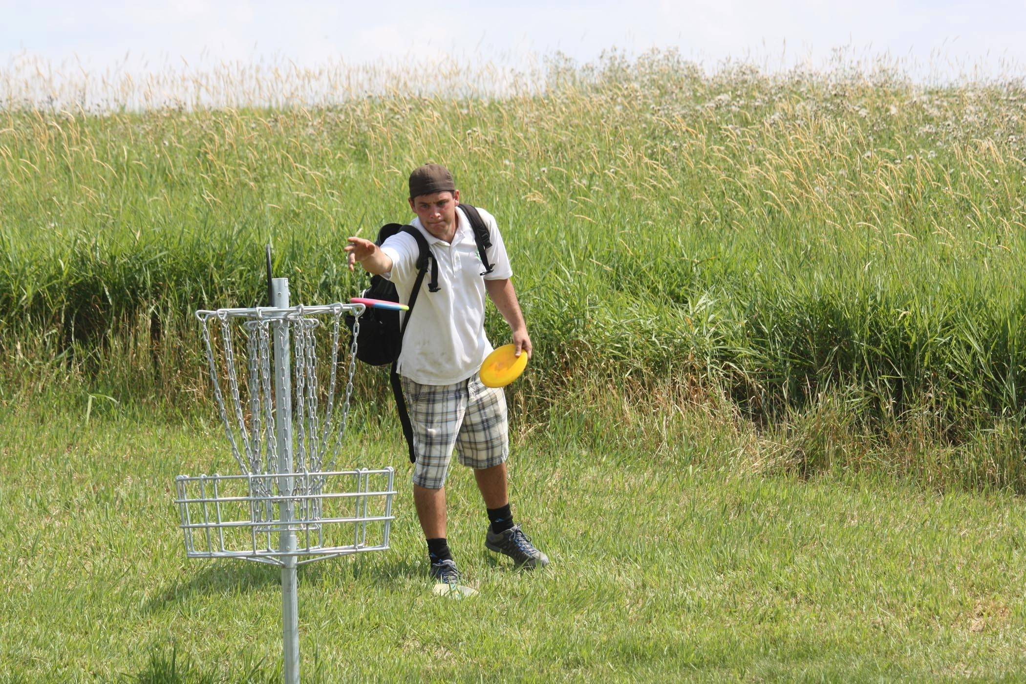 A disc golfer sizes up the basket during a previous Palatine Park District tournament. The park district, home to the 18 hole disc golf course at Margreth Riemer Reservoir, is hosting two disc golf events in June. Visit www.palatineparks.org for details.