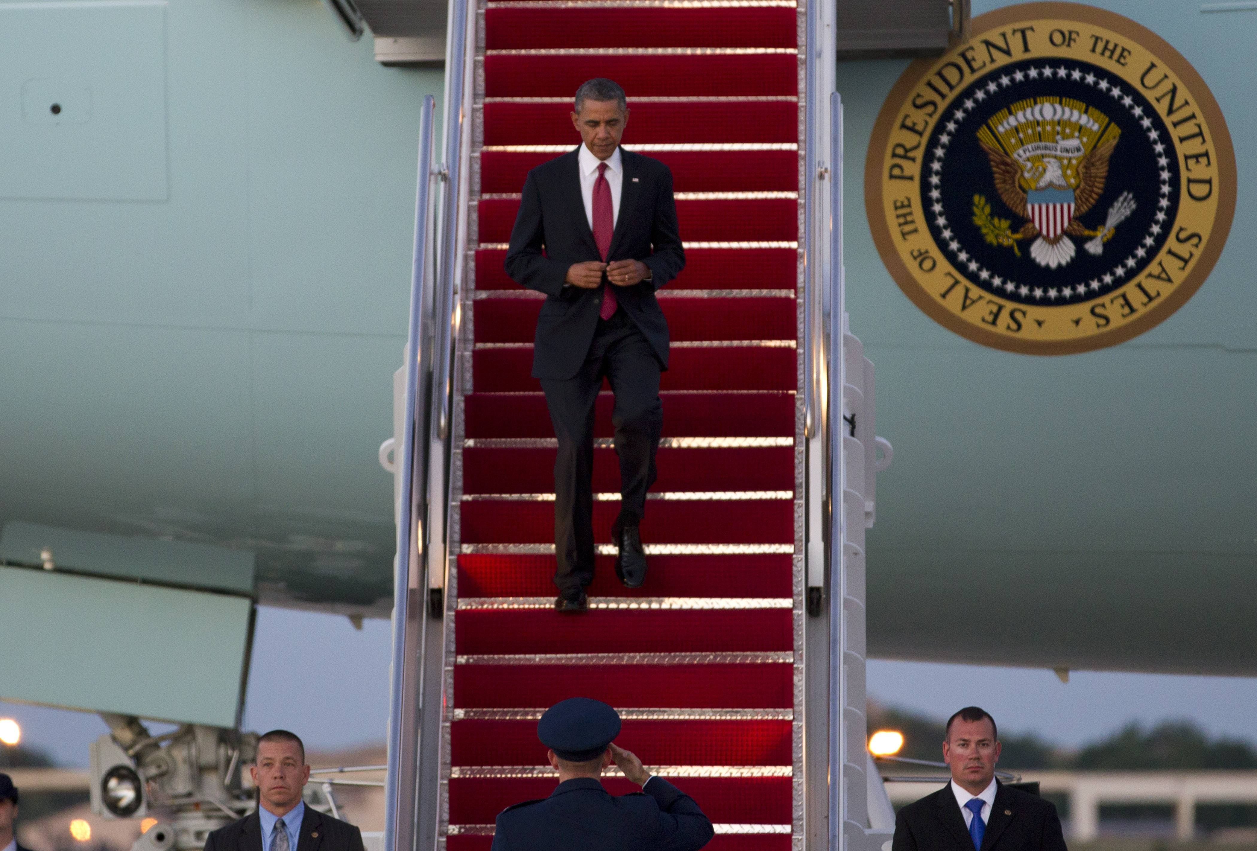 President Barack Obama walks down the stairs from Air Force One, upon arrival Friday at Andrews Air Force Base, Md.