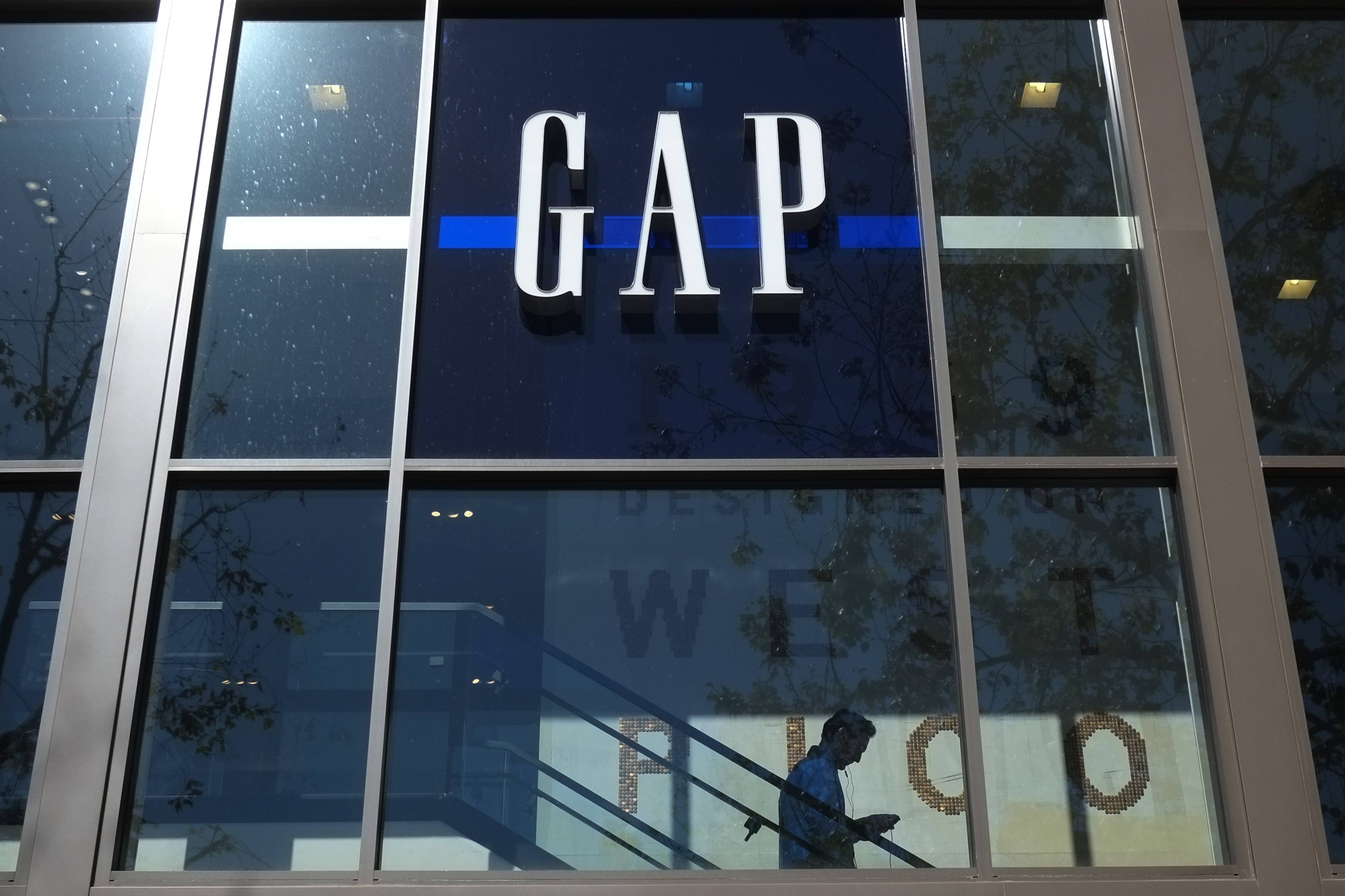 A shopper walks down the steps at a Gap store in Los Angeles. Gap Inc. has announced plans to produce clothing in Myanmar.