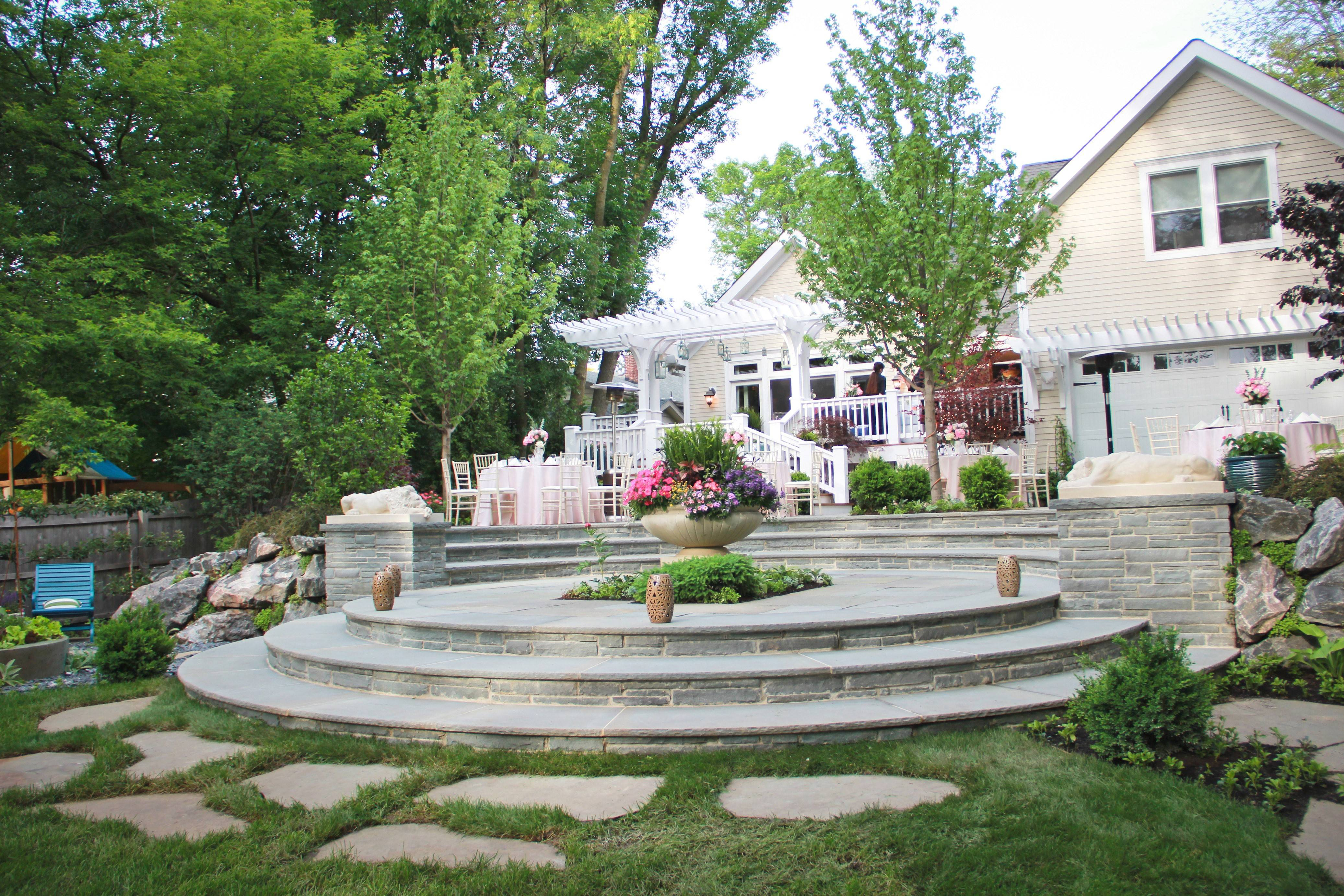 Round is the theme for the landscaping for this foursquare home near downtown Barrington. The circular terrace makes a great conversation area and the design links the home and the landscape.