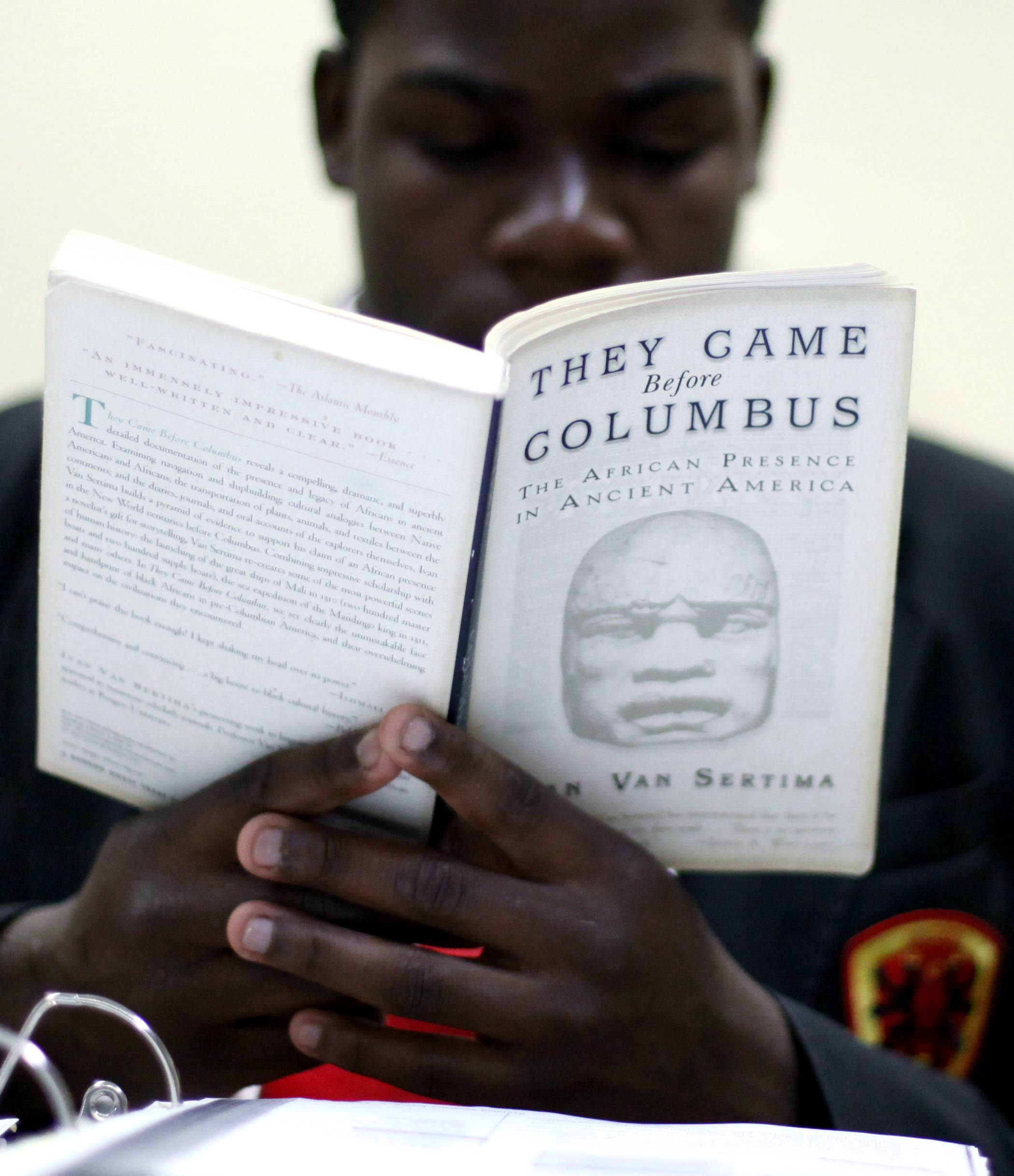 Urban Prep student Jeremiah Stovall reads in Mr. Stewart's class in Chicago. The school has a rigorous set of academic standards including a double dose of English and mandatory 20 minutes of reading daily, assessments every six weeks and Saturday classes with summer school for those who need it.