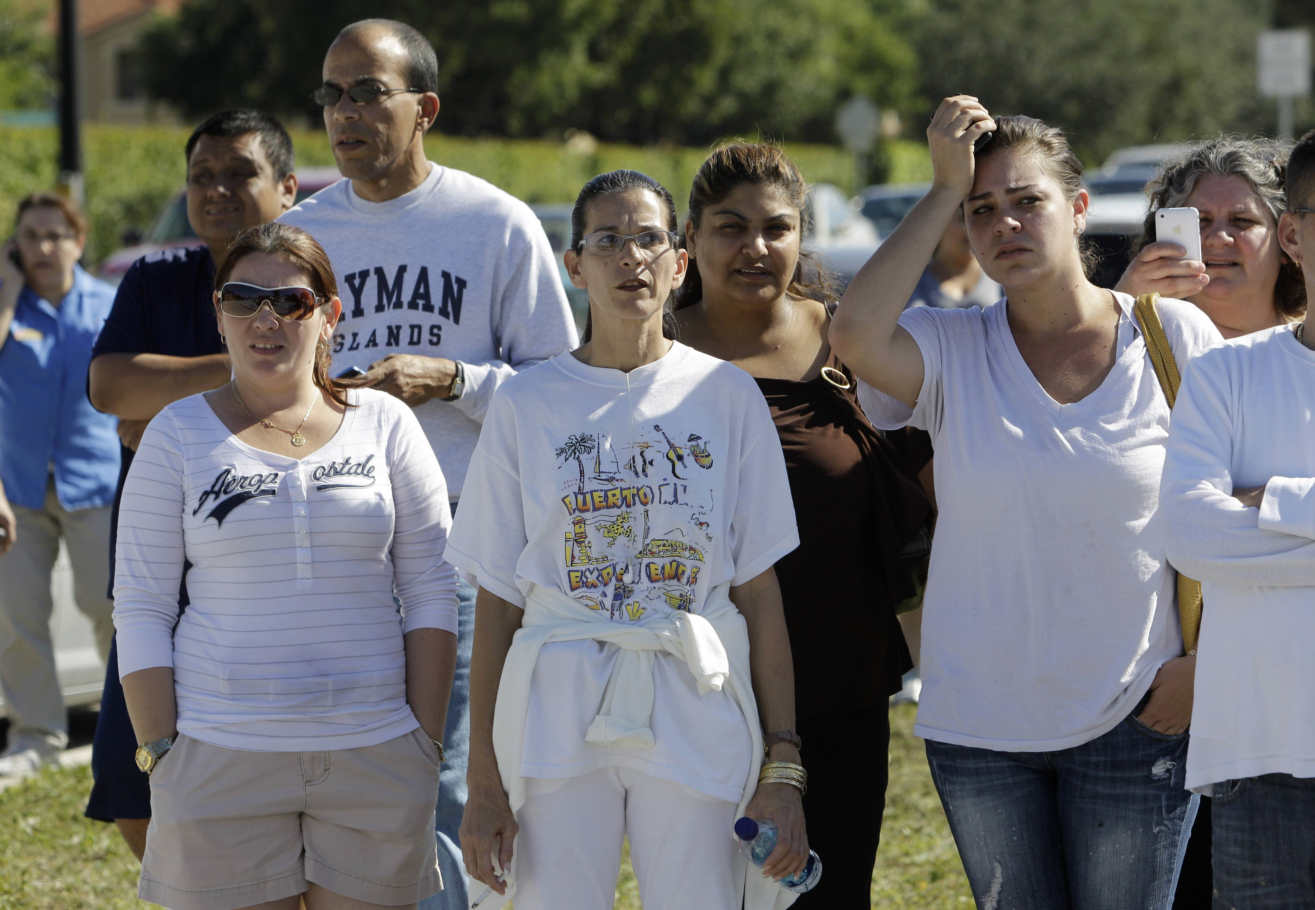 "Associated Press/Nov. 10, 2010 Parents wait to pick up their children at Lakeside Elementary School in Pembroke Pines, Fla., after authorities lifted a lockdown of all schools in Broward County. The threatening comments of a Florida woman about ""Second Amendment gun rights"" triggered the lockdow."