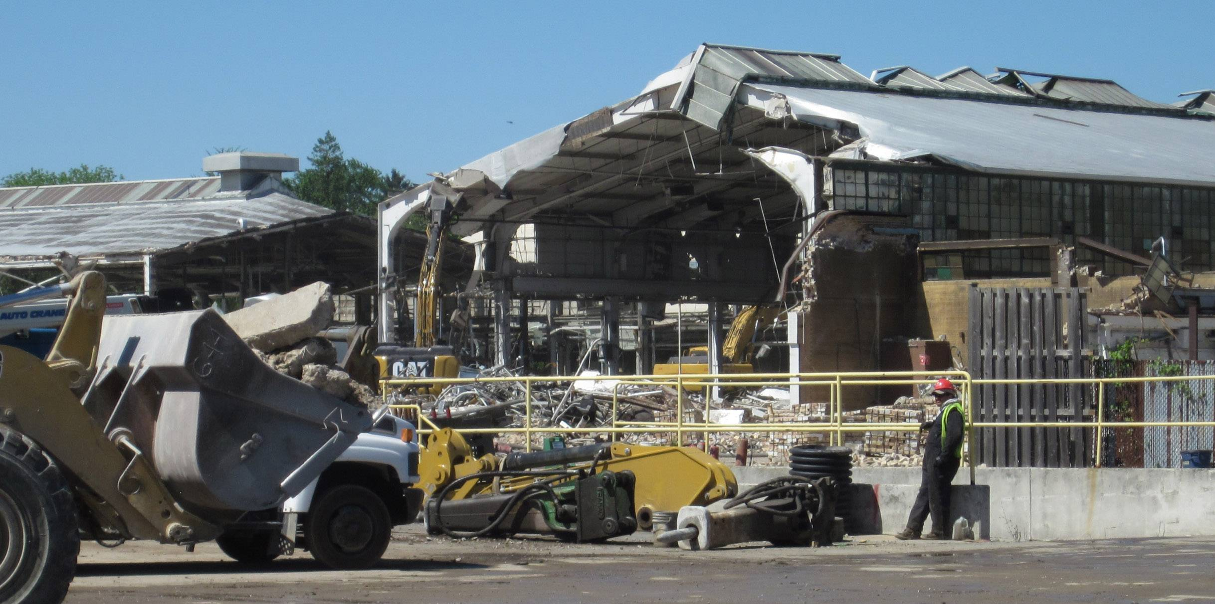 Crews continue the demolition of a portion of the former Frank G. Hough Co. in Libertyville. About 3,000 people once worked at the industrial campus making heavy equipment at what became an innovator in the field.