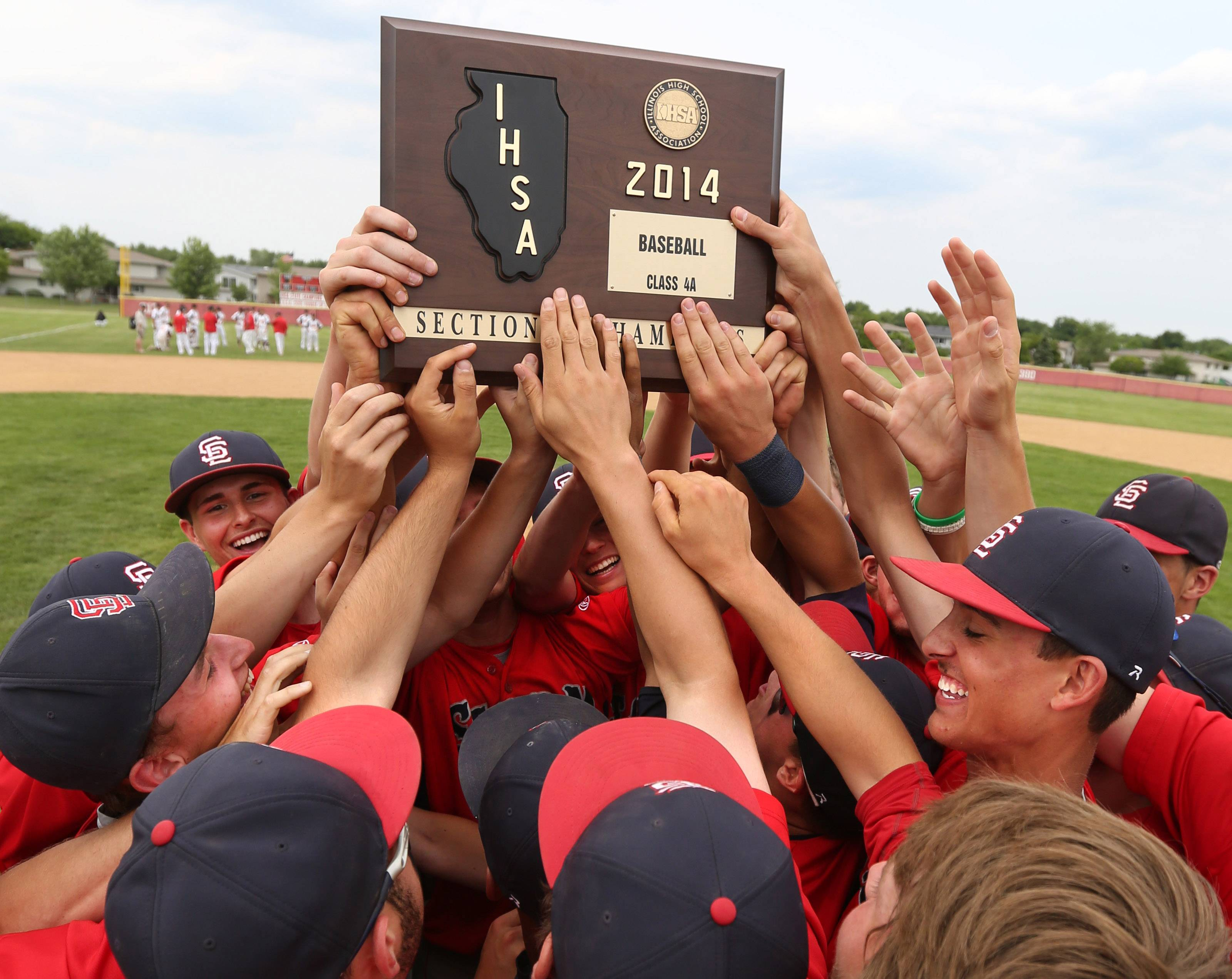 South Elgin celebrates with the sectional plaque after topping Batavia 8-3 on Saturday in the Schaumburg sectional championship game.