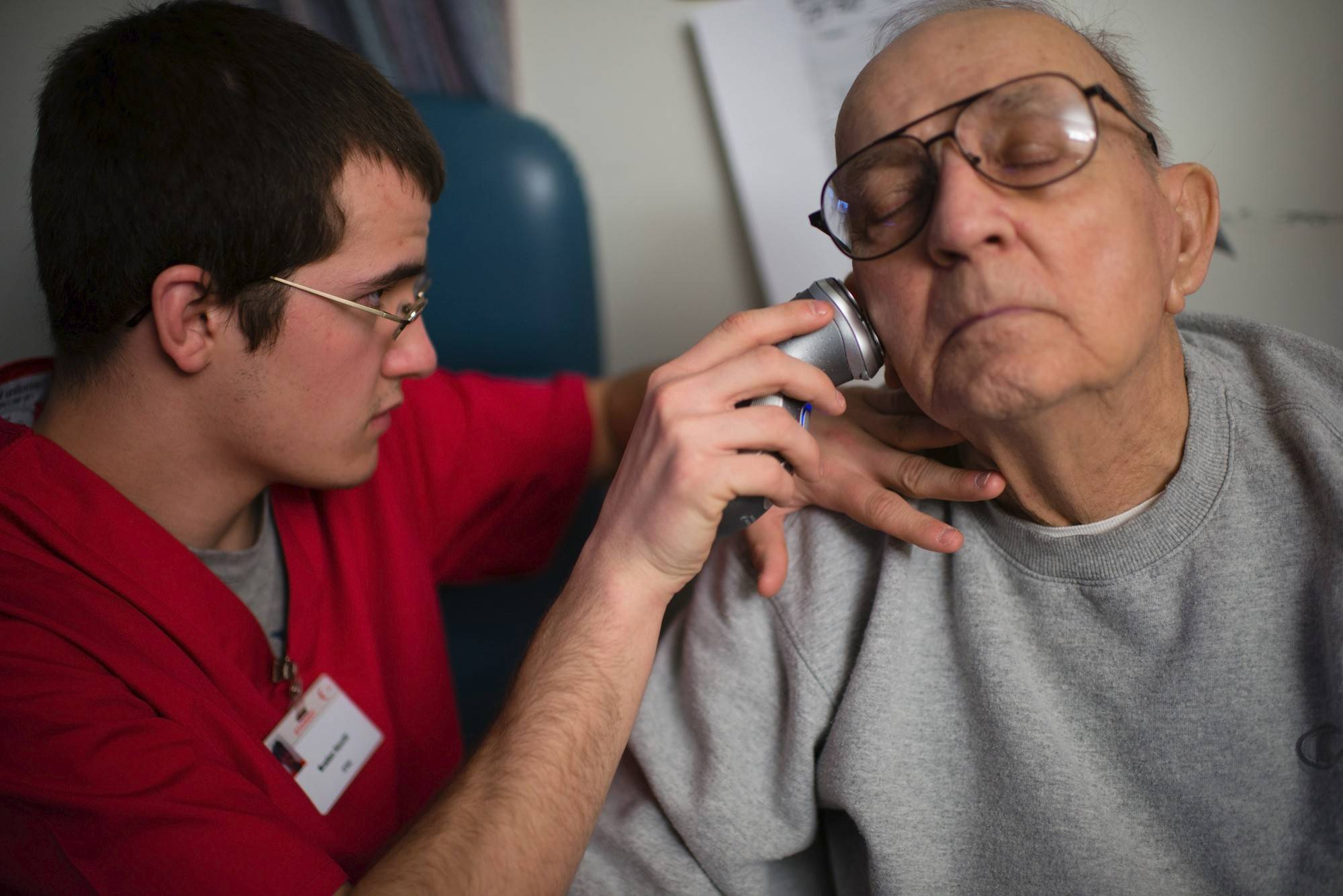 Braden Hewitt shaves John Childress during student training with residents of the Harmar Place nursing home in Marietta, Ohio.
