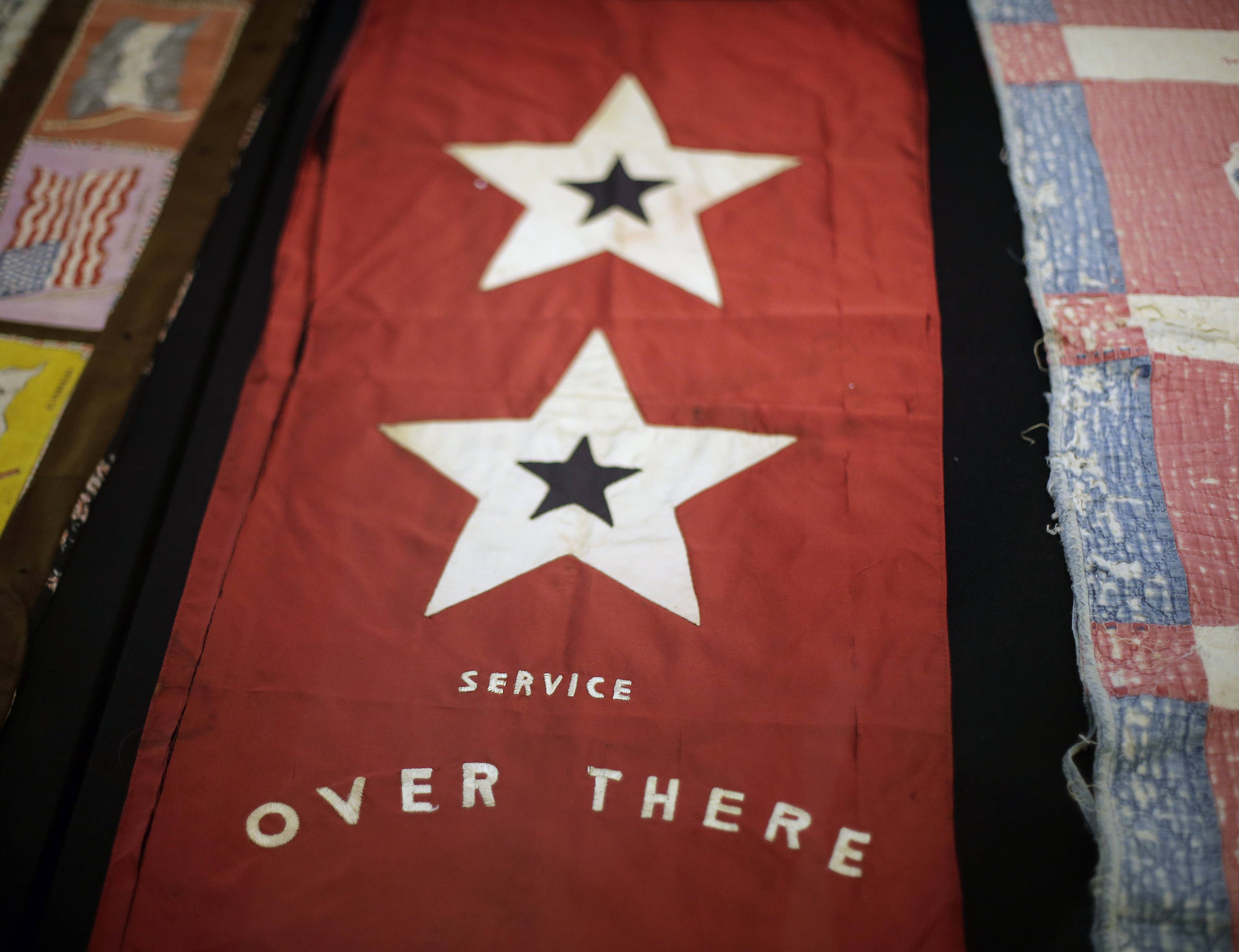 A banner indicating that two people from a home were serving in the military is on display at the National World War I Museum at Liberty Memorial in Kansas City, Mo.