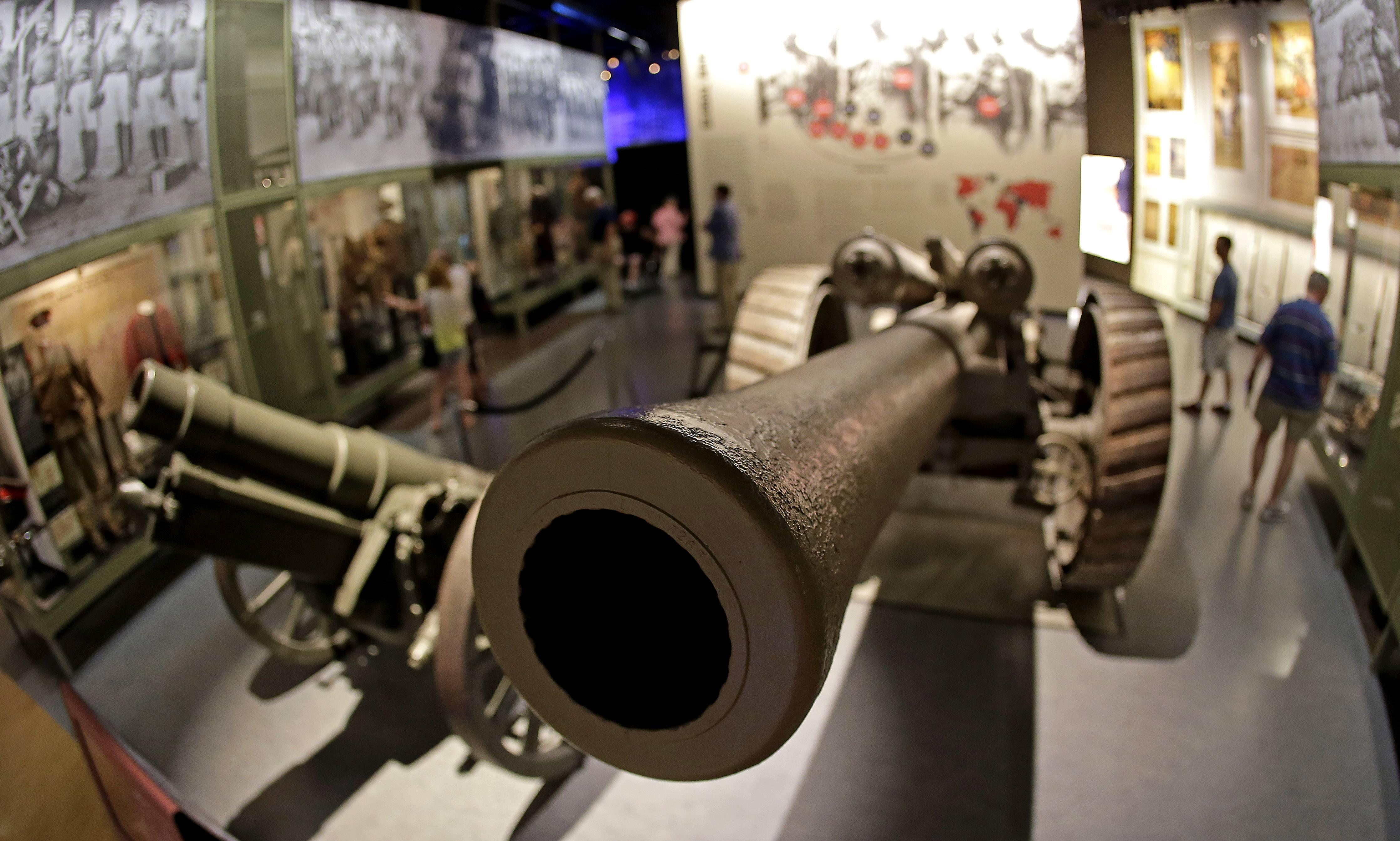 Visitors view a display, including a British heavy field gun, right, and a German howitzer, at the National World War I Museum in Kansas City, Mo.