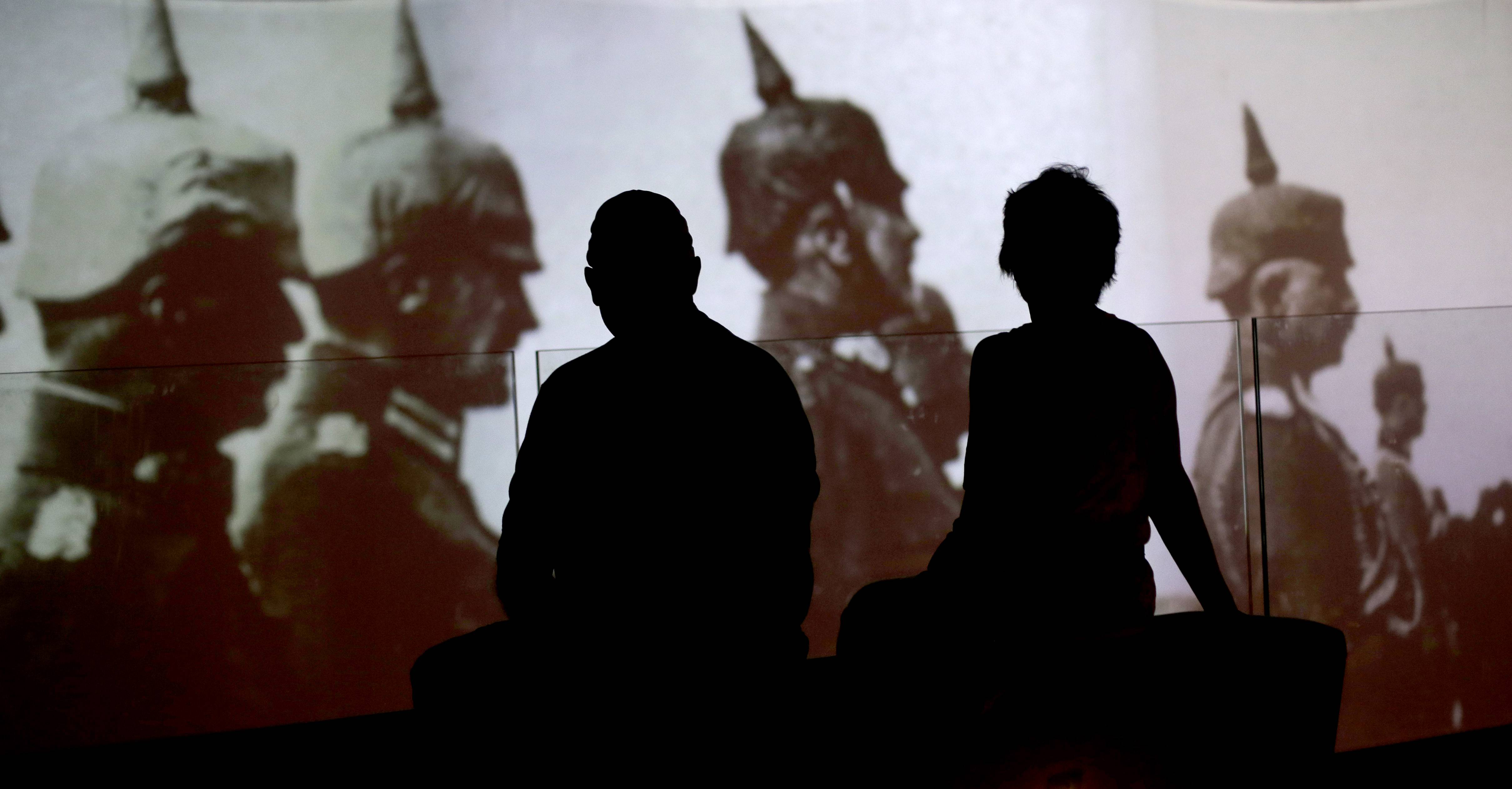 Visitors watch a video detailing the events leading up to the United States' entrance into the war at the National World War I Museum.