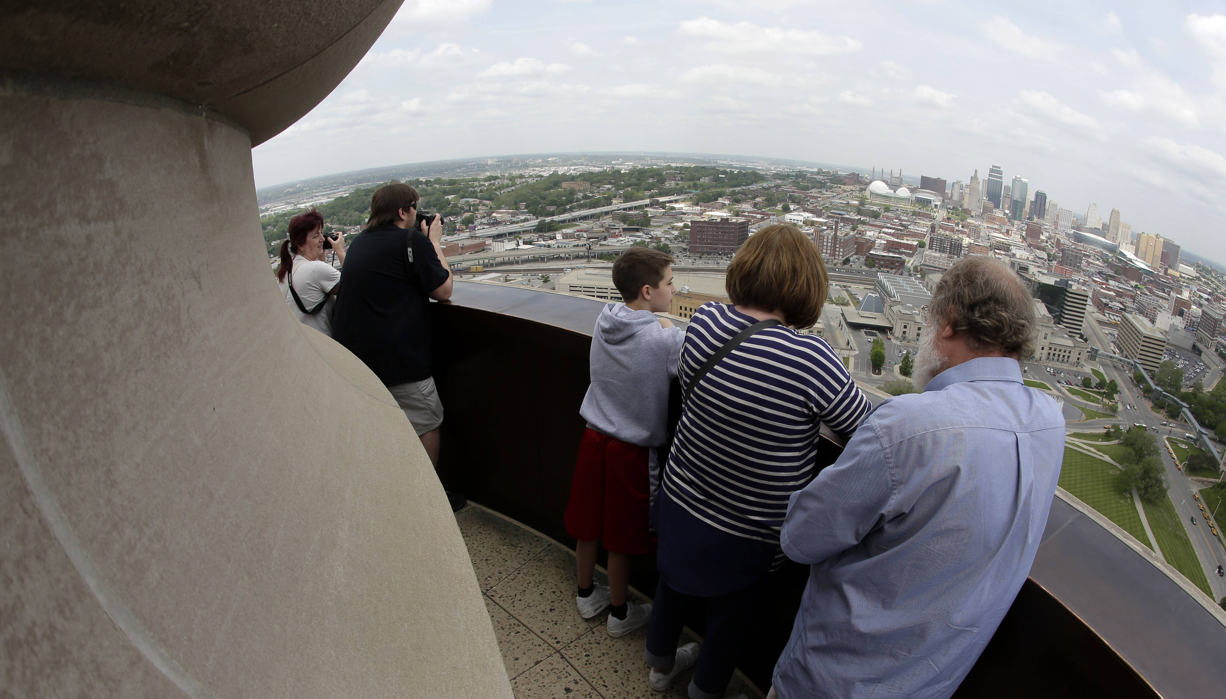 Visitors survey the Kansas City, Mo., skyline from the top of the 277-foot Liberty Memorial Tower above the plaza at the National World War I Museum.
