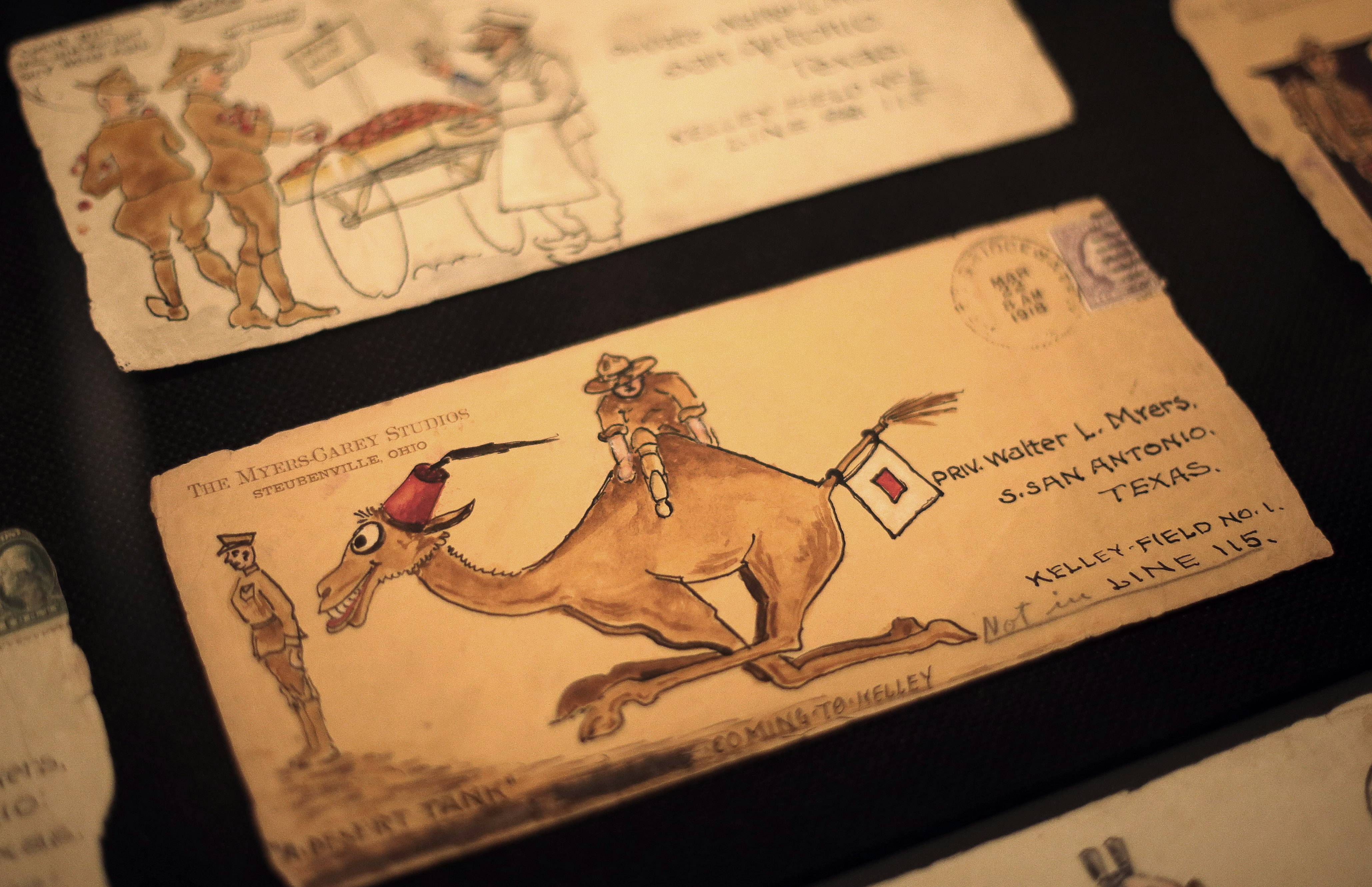 Envelopes containing letters from an artist father to his soldier son are display at the National World War I Museum.
