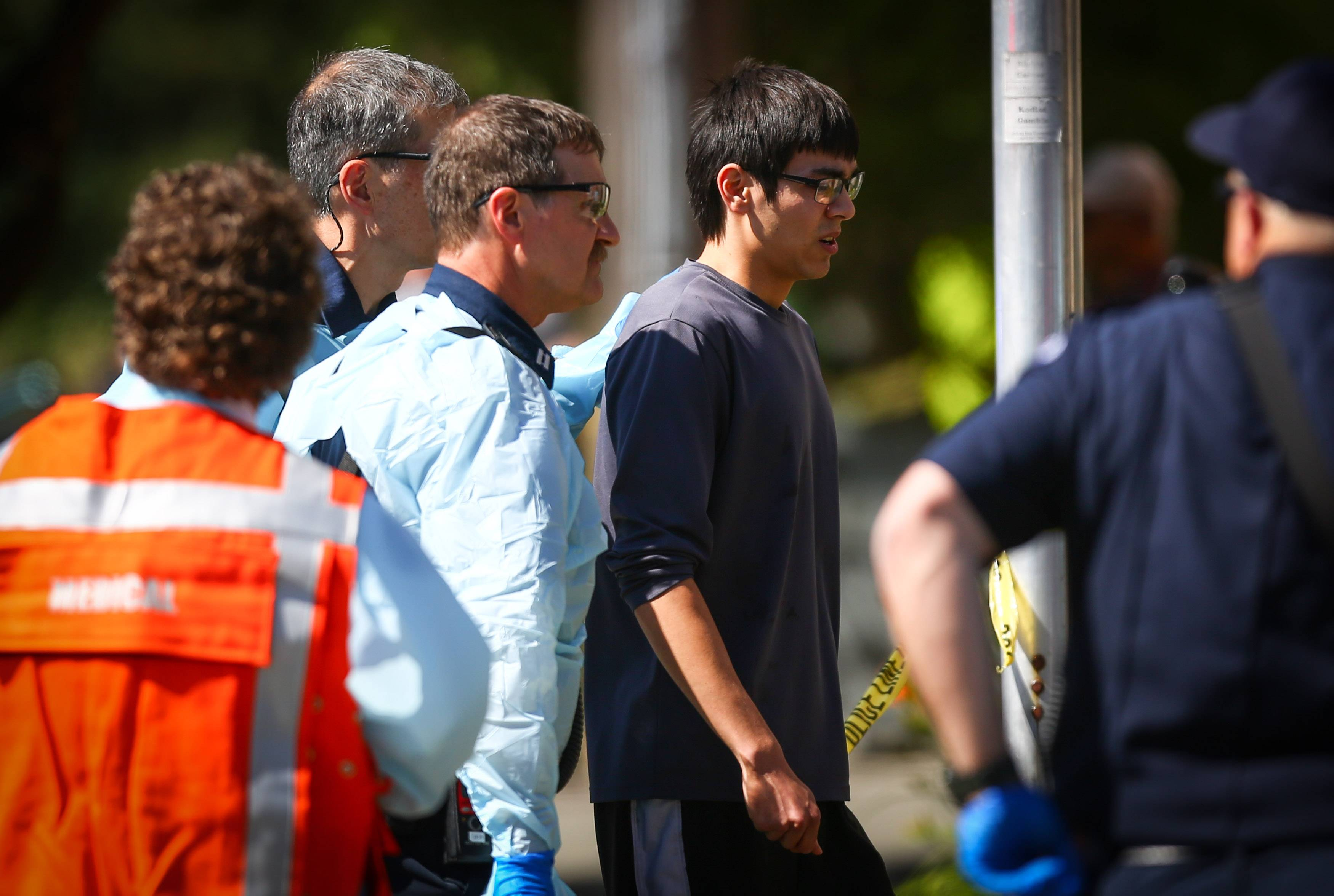 Jon Meis is taken from the scene by medics after a shooting Thursday at Seattle Pacific University.