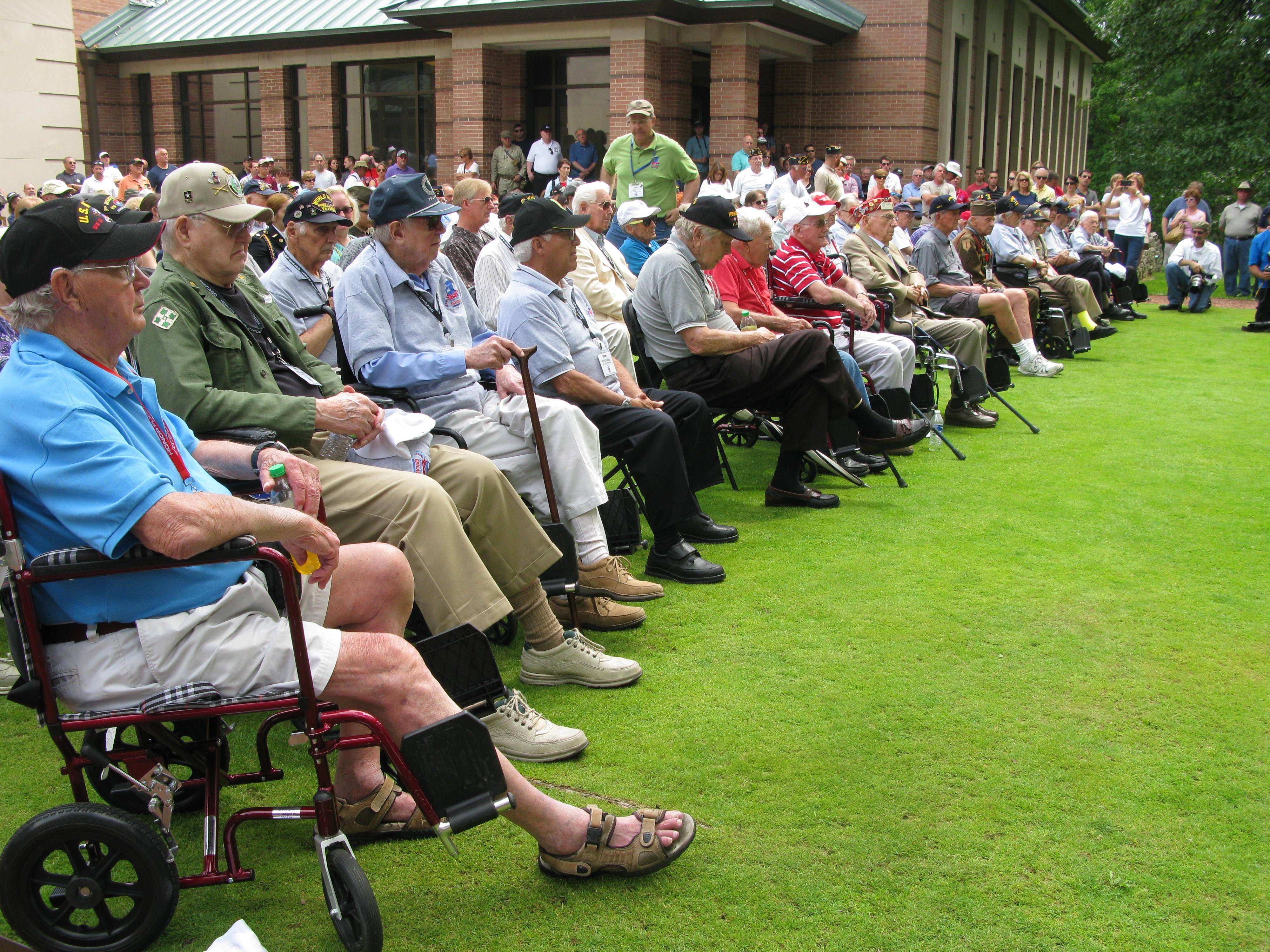 World War II veterans sit in the first row during the 70th anniversary commemoration of D-Day, the Allied invasion of France, Saturday at Cantigny Park in Wheaton.