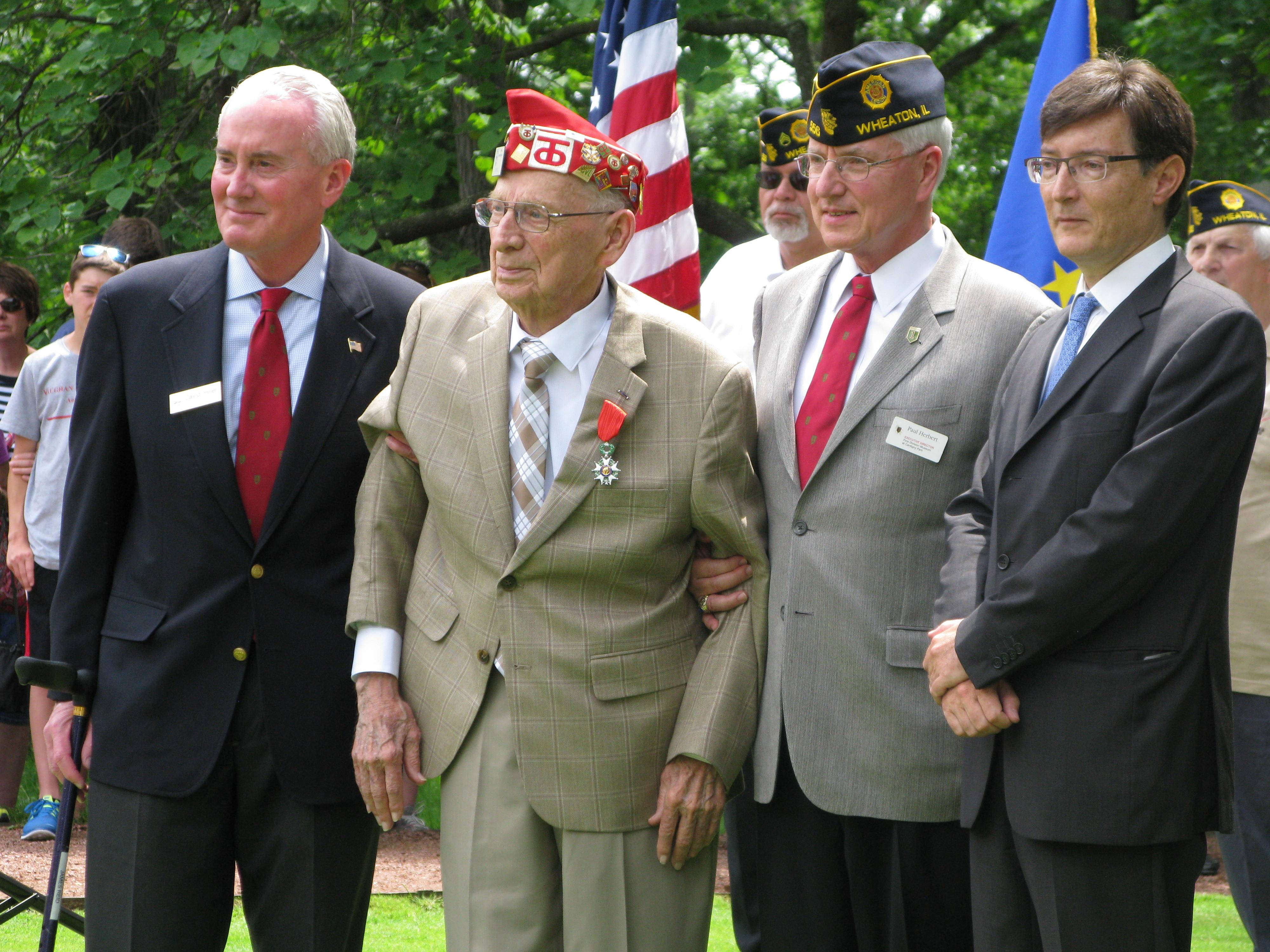 From left, David Hiller, CEO of the Robert R. McCormick Foundation and Cantigny Park, James Reid of Oak Brook, recipient of the French Legion of Honor medal, Paul Herbert, director of the First Division Museum at Cantigny, and Graham Paul, consul general of France to Chicago, during the 70th anniversary commemoration of D-Day at Cantigny Park in Wheaton.