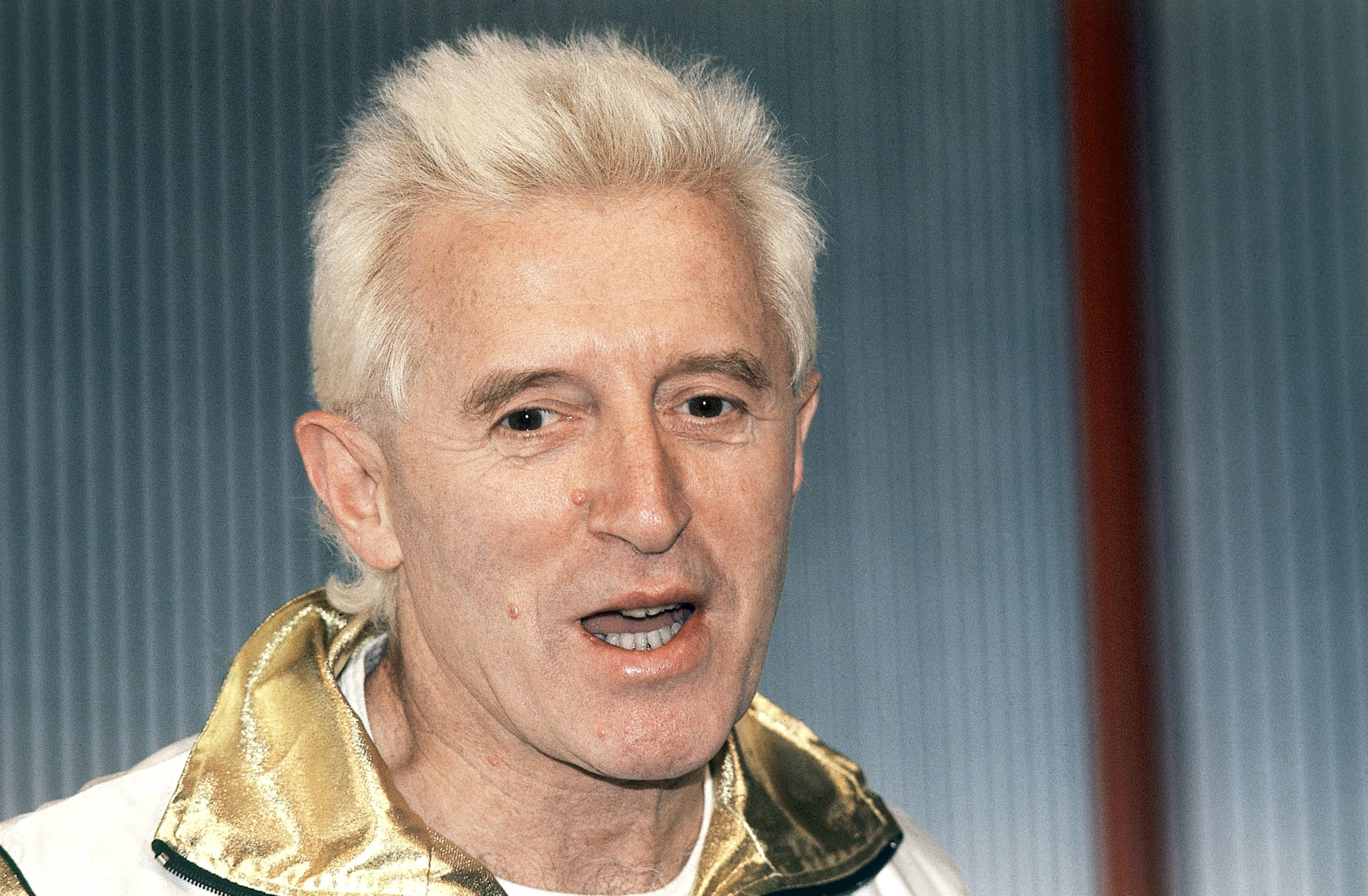 Disc jockey and presenter on Britain's Radio 1, Jimmy Savile, is pictured at Madame Tussauds museum in London, England.