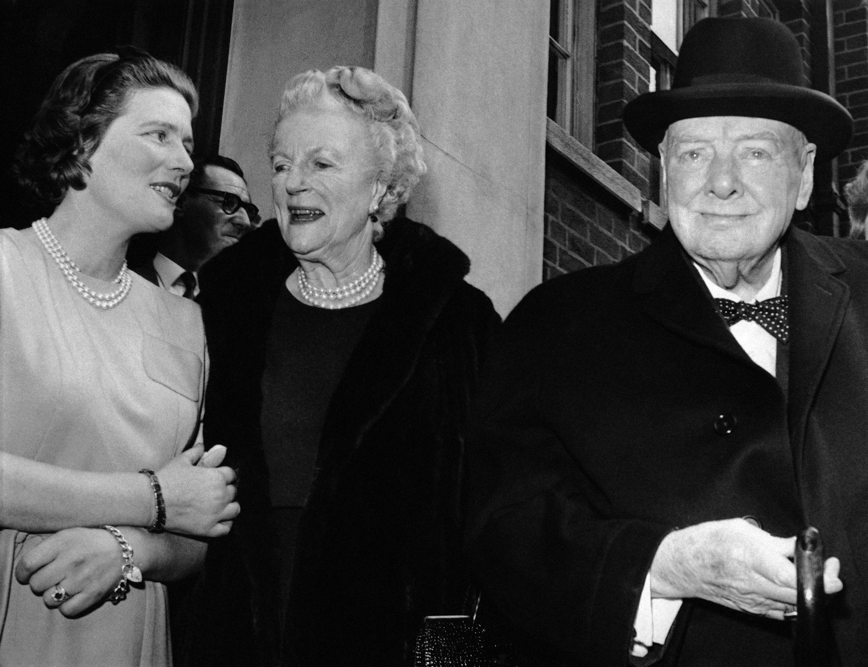 Sir Winston and Lady Clementine Churchill, take their leave of their daughter Mary, wife of Agriculture Minister Christopher Soames, after a family luncheon party to celebrate Lady Churchill's 78th birthday at Tufton Court, London.