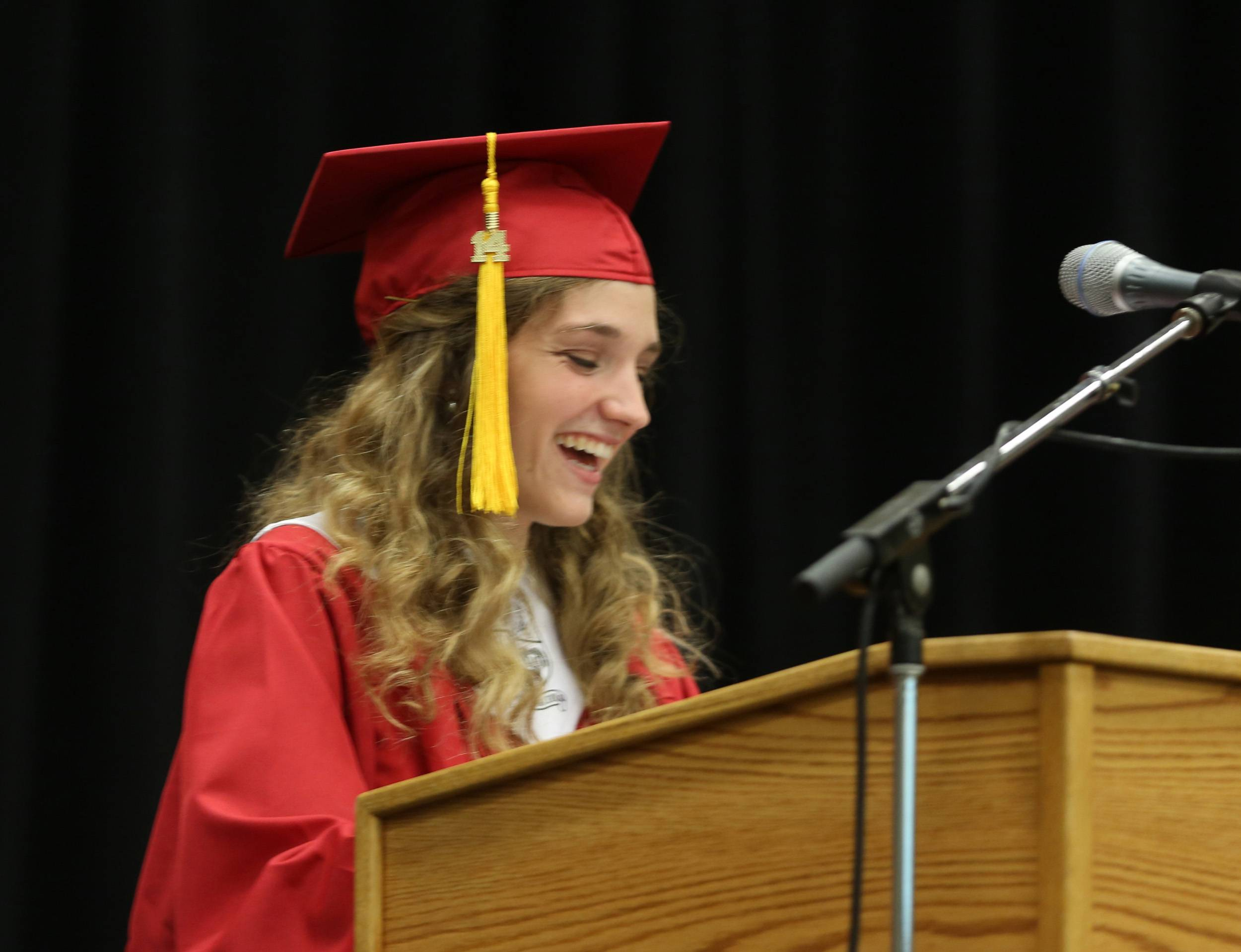 Rachel Callaly greets the Class of 2014 during the Glenbard East High School graduation at the College of DuPage in Glen Ellyn.