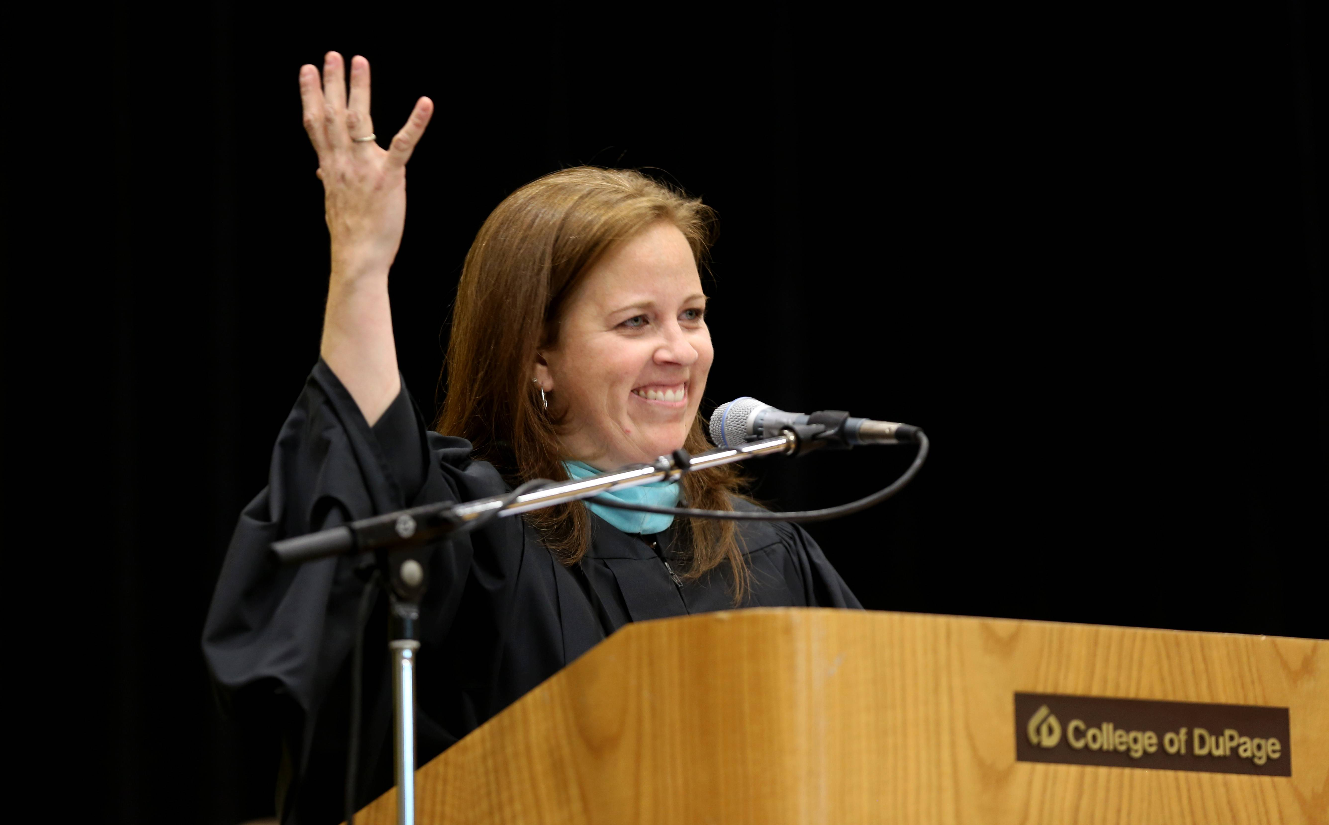 After receiving the Hennessey Award, Jennifer Diamantos addresses the Glenbard North High School Class of 2014, at the College of DuPage.