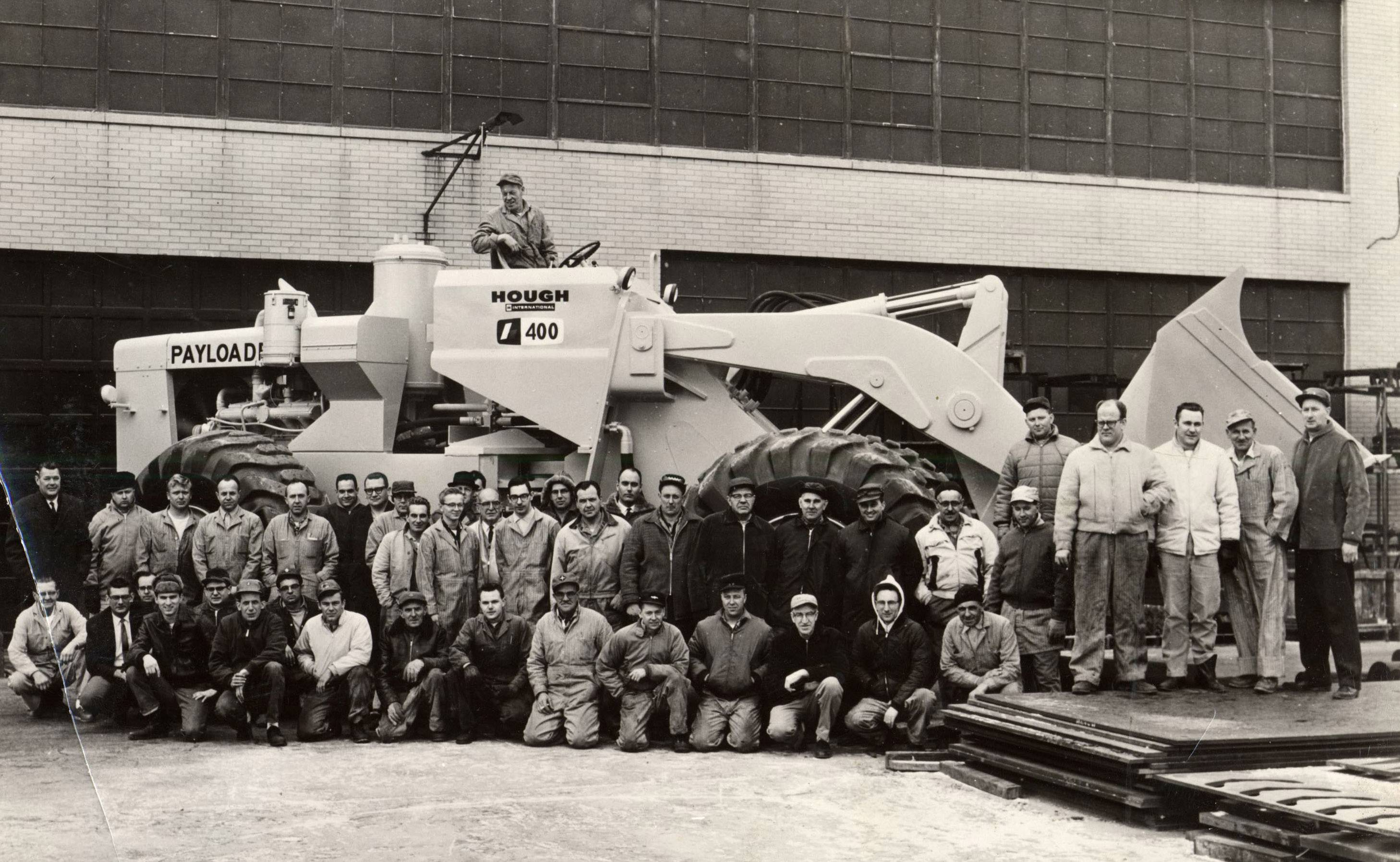 Hough-International Harvester employees with the PAYloader tractor shovel at the Libertyville manufacturing plant circa 1965.