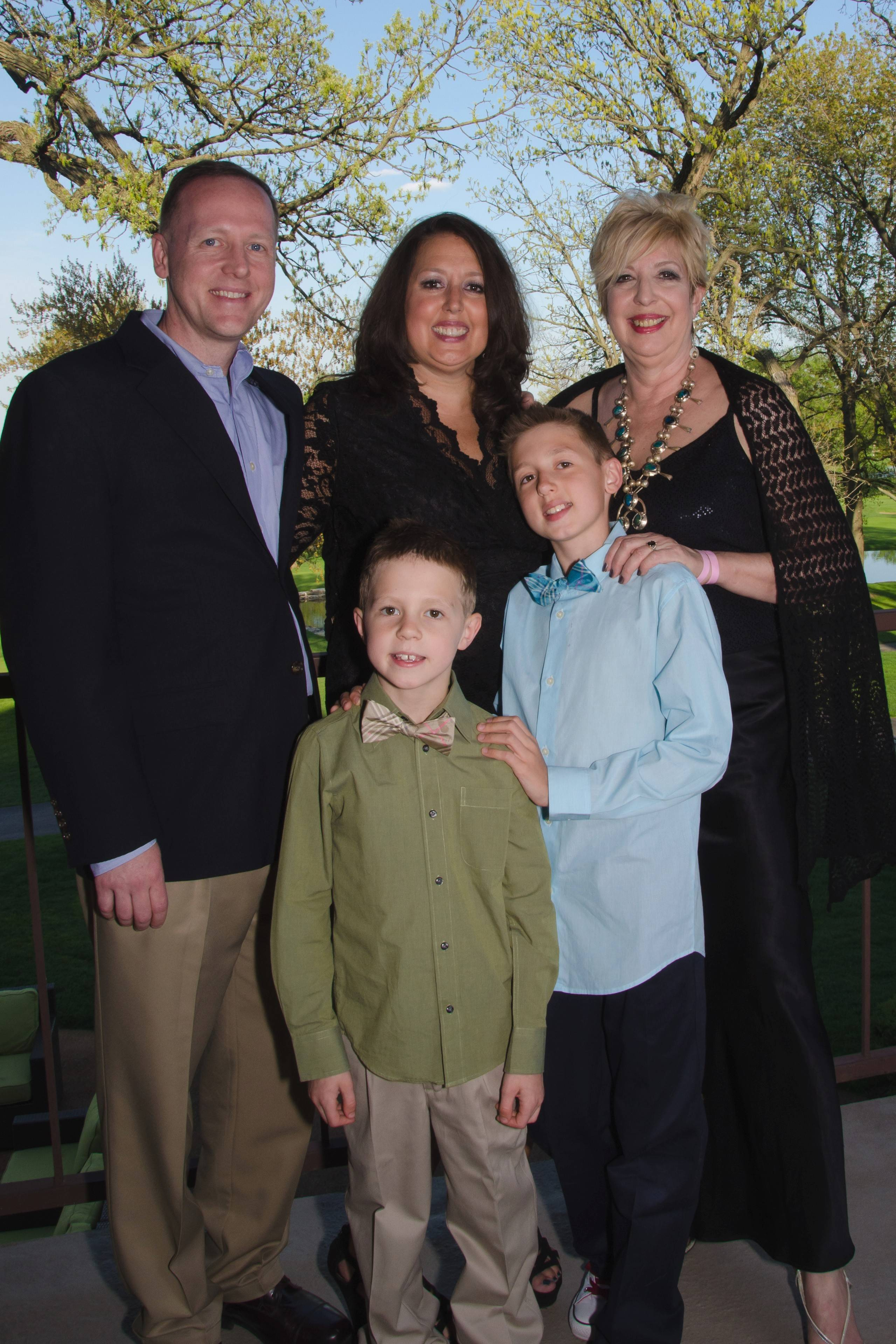 Summer White Lynch, center, with her husband Michael, mother Jan White, and sons Aiden and Dylan.