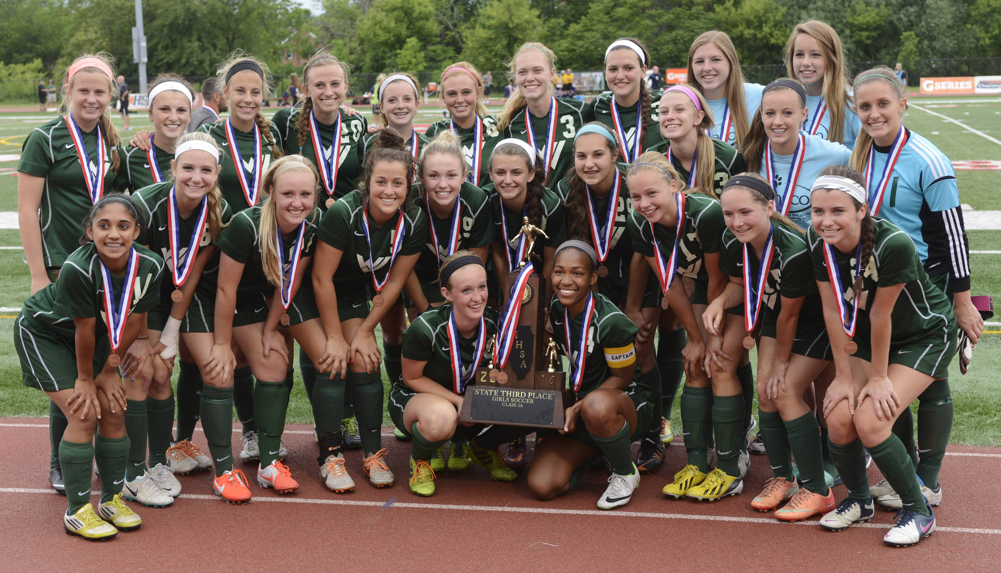 Waubonsie Valley players pose with the third-place girl's soccer trophy after their win over Lincoln-Way North at North Central College in Naperville Saturday.