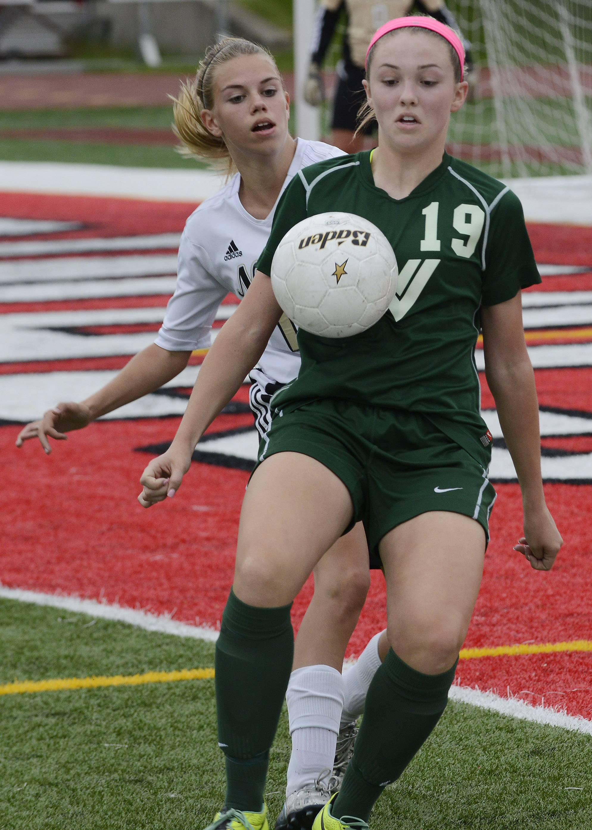 Waubonsie Valley's Maggie Roe controls the ball in front of Lincoln-Way North's Ava Eggert during the Class 3A state third-place game at North Central College in Naperville on Saturday.