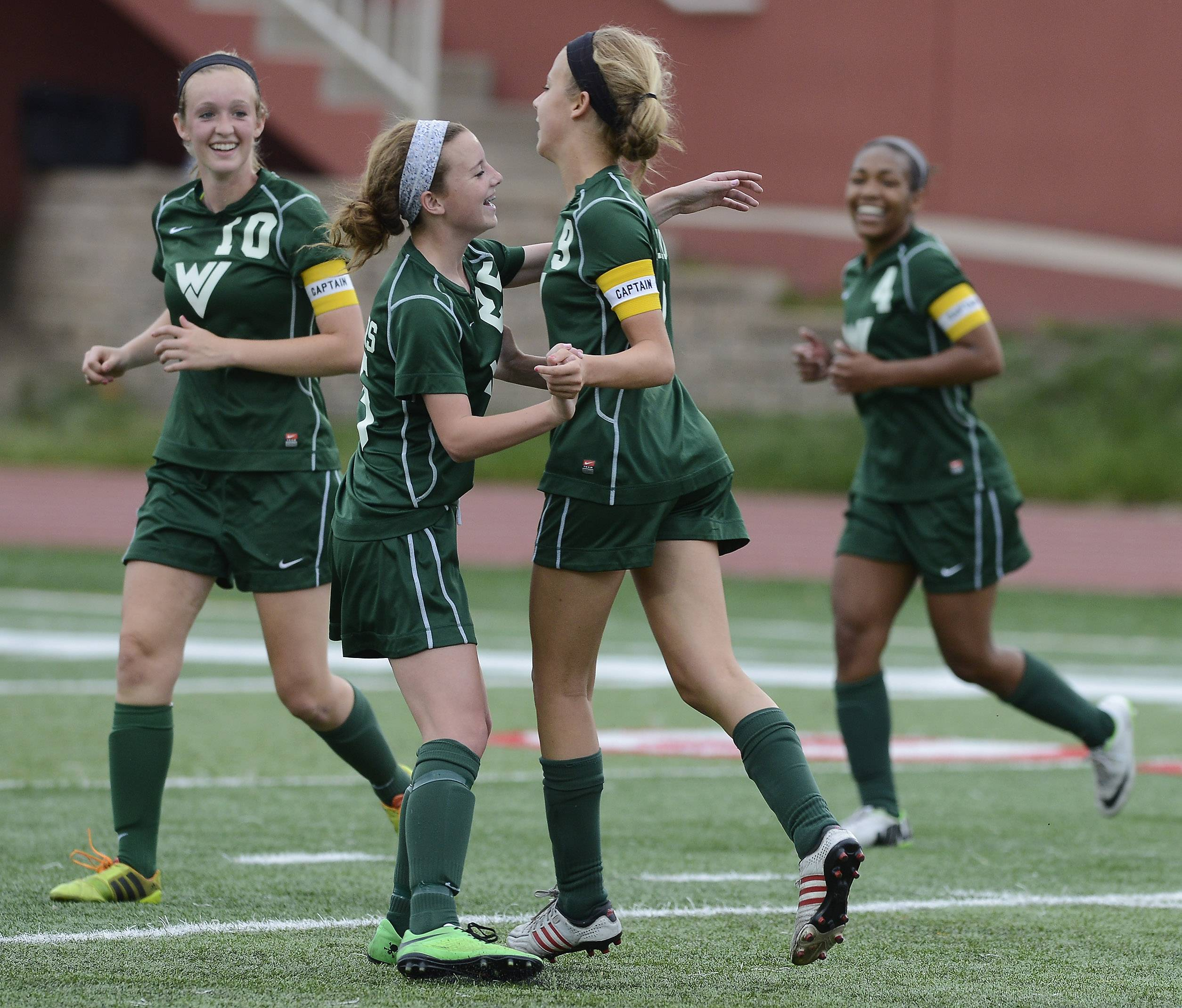 Rachael Brots, second from right, of Waubonsie Valley celebrates her first-half goal with teammates, from left,  Mackenzie Fuller, Sarah Griffith and Kristen Dodson during the Class 3A state third-place game against Lincoln-Way North at North Central College in Naperville on Saturday.