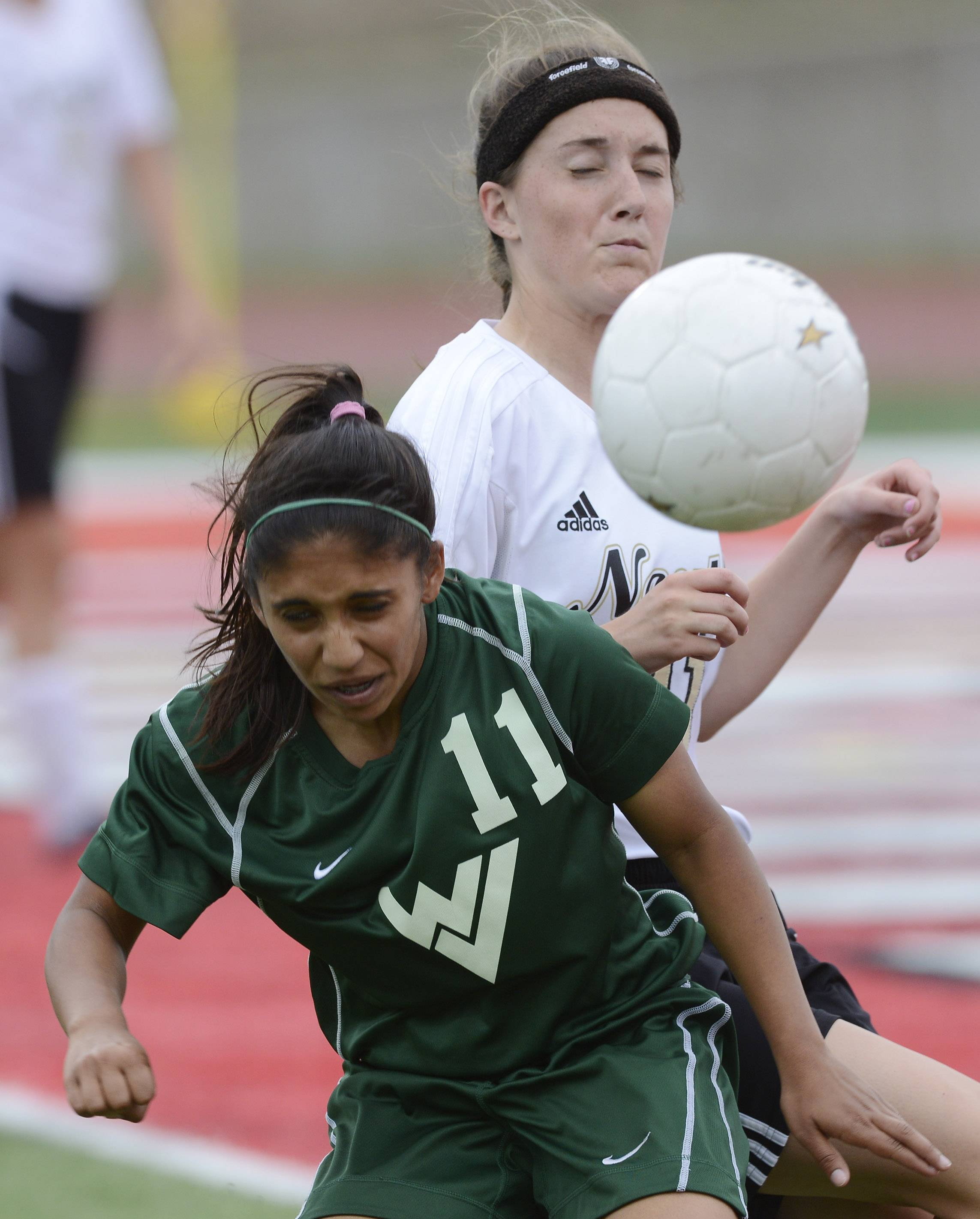 CiCi Gazder of Waubonsie Valley gets in front of Carly Marchal of Lincol-Way North during the girls soccer Class 3A state third-place game at North Central College in Naperville Saturday.