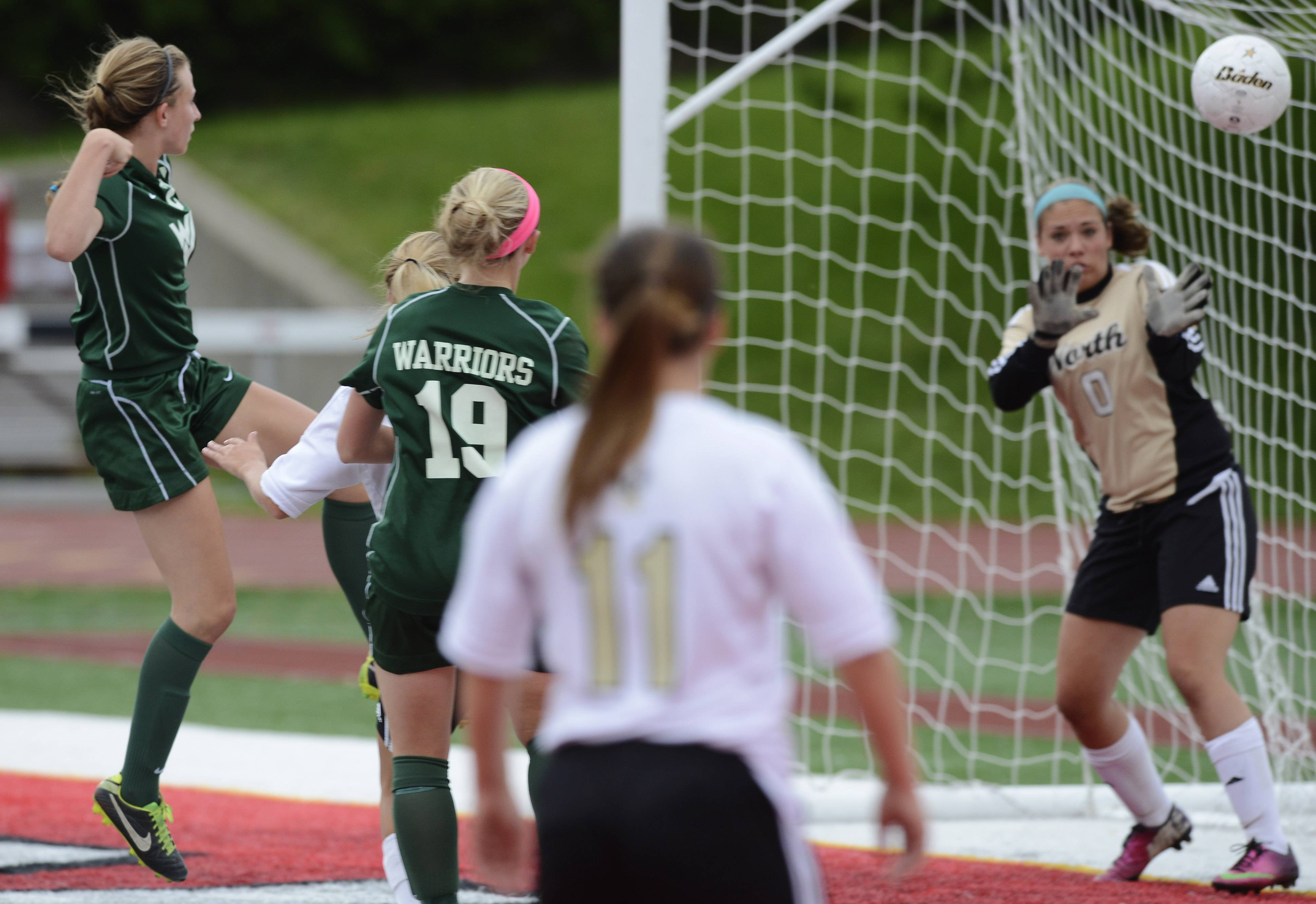 Emily Dickens of Waubonsie Valley scores a first-half goal during the girls soccer Class 3A state third-place game against Lincoln-Way North at North Central College in Naperville Saturday.