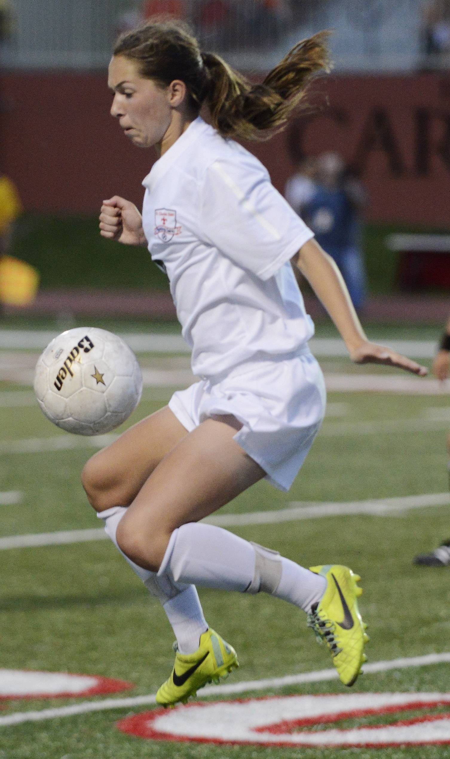 Darcy Cunningham of St. Charles East leaps for the ball during the girls soccer Class 3A state final at North Central College in Naperville Saturday.