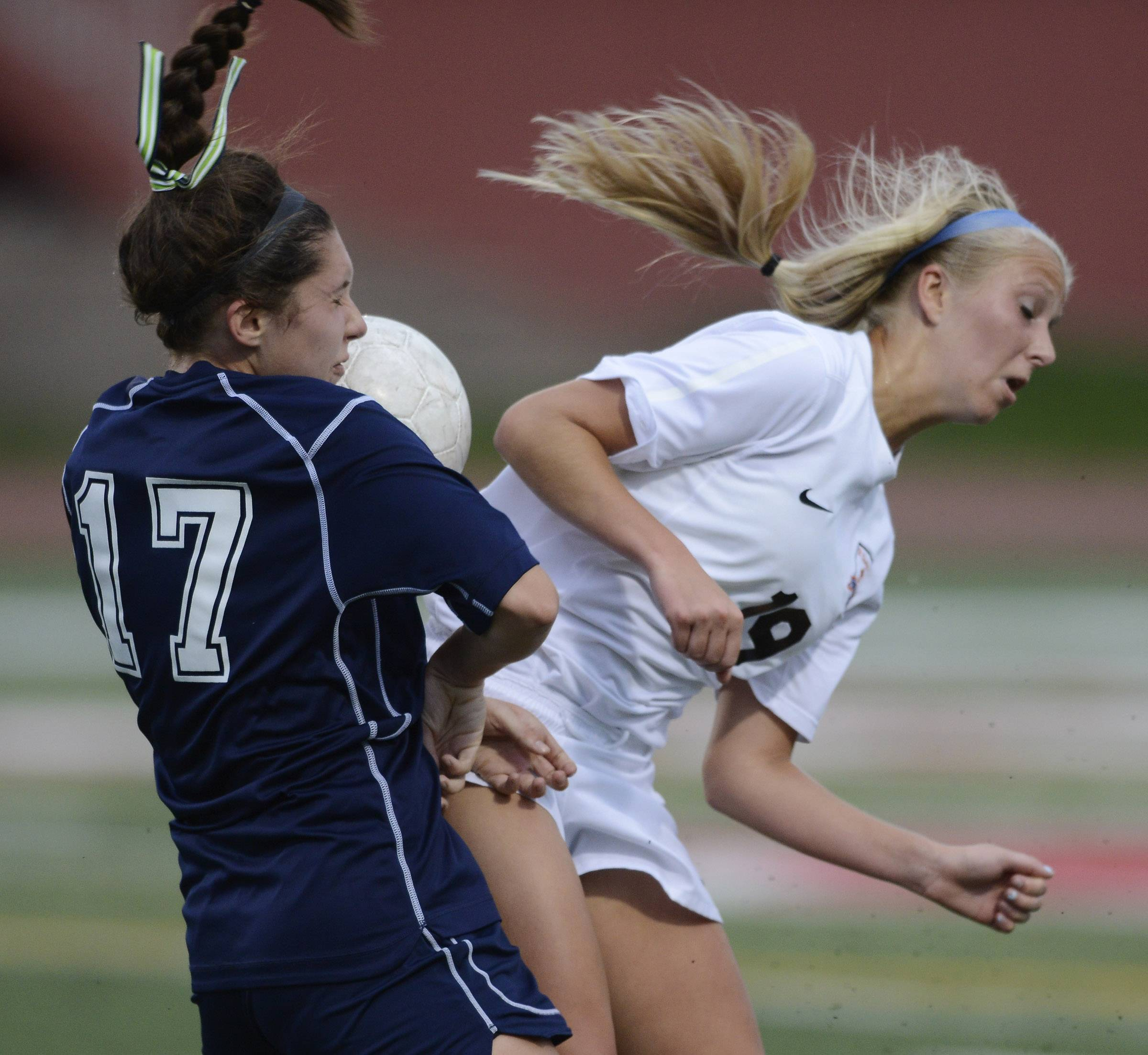 Caroline Smith, left, of New Trier and Sophie Jendrzeczyk of St. Charles East make contact as the pursue the ball during the girls soccer Class 3A state final at North Central College in Naperville Saturday.
