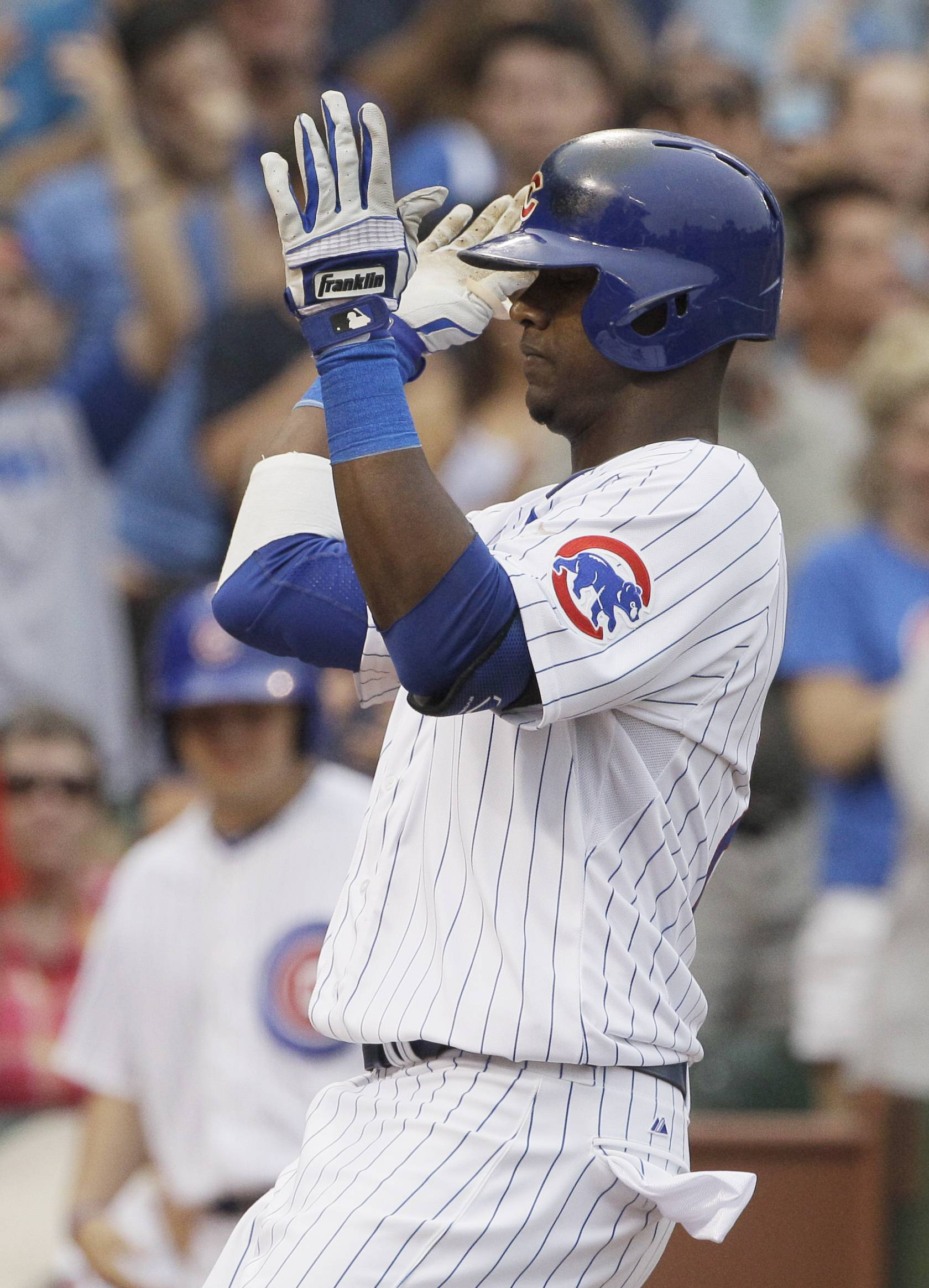 The Cubs' Junior Lake celebrates in the seventh inning after hitting his second solo home run in Saturday's victory over the Marlins at Wrigley Field.