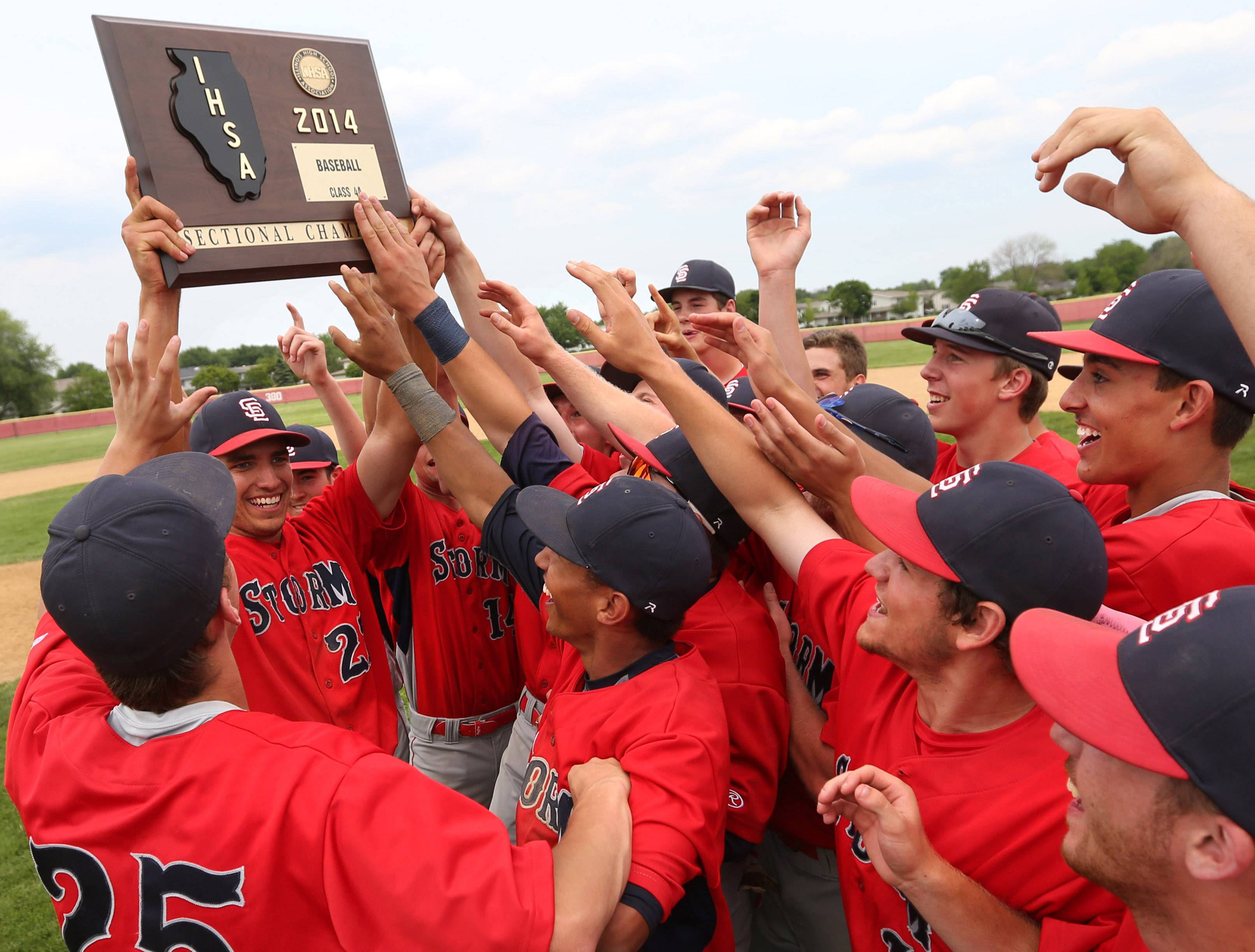 South Elgin's Ryan Nutof holds the sectional plaque for teammates after the Storm's 8-3 win over Batavia in the Schaumburg sectional championship game Saturday.