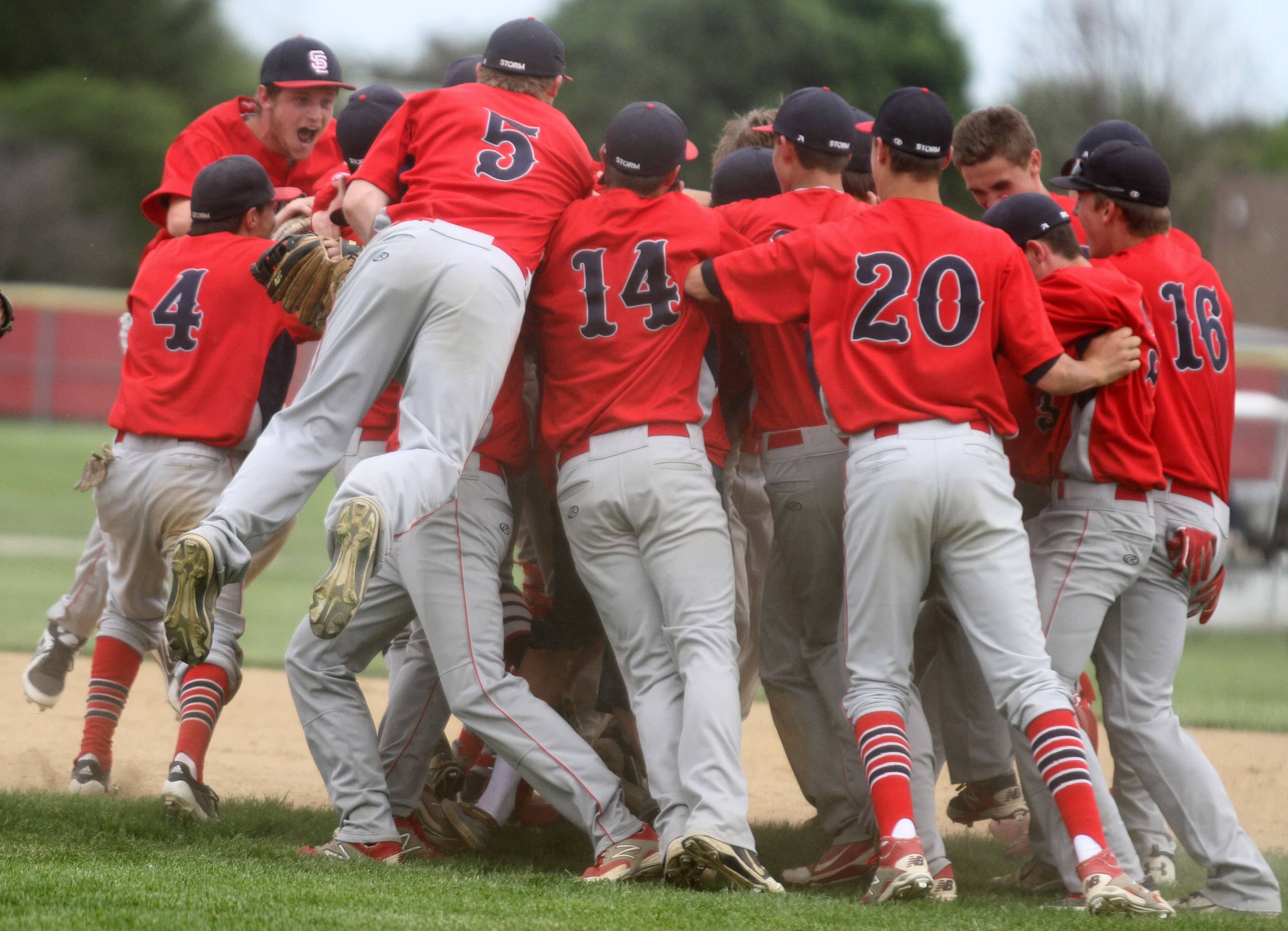 South Elgin rushes the field as the Strom tops Batavia 8-3 on Saturday in the Schaumburg sectional championship game.
