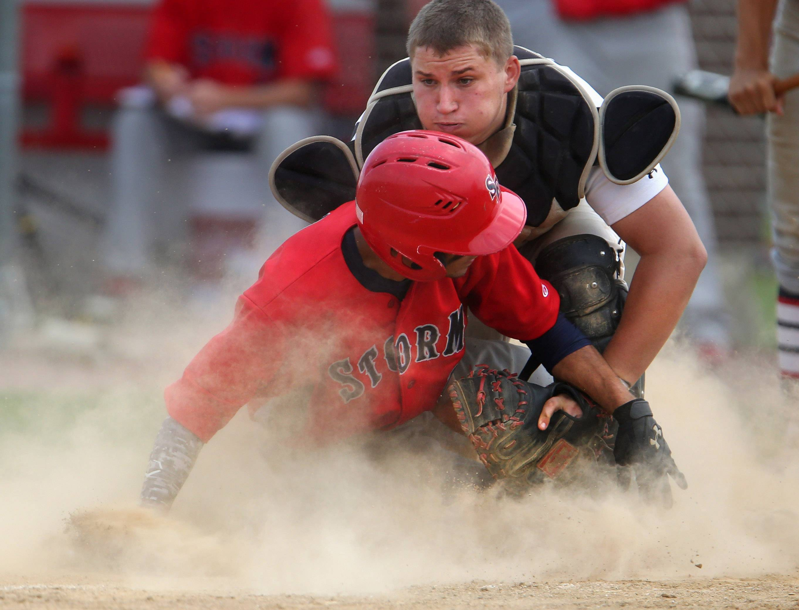Batavia catcher Dino Simoncelli tags out South Elgin's Dane Toppel at home plate during South Elgin's 8-3 victory in the Schaumburg sectional championship game Saturday.