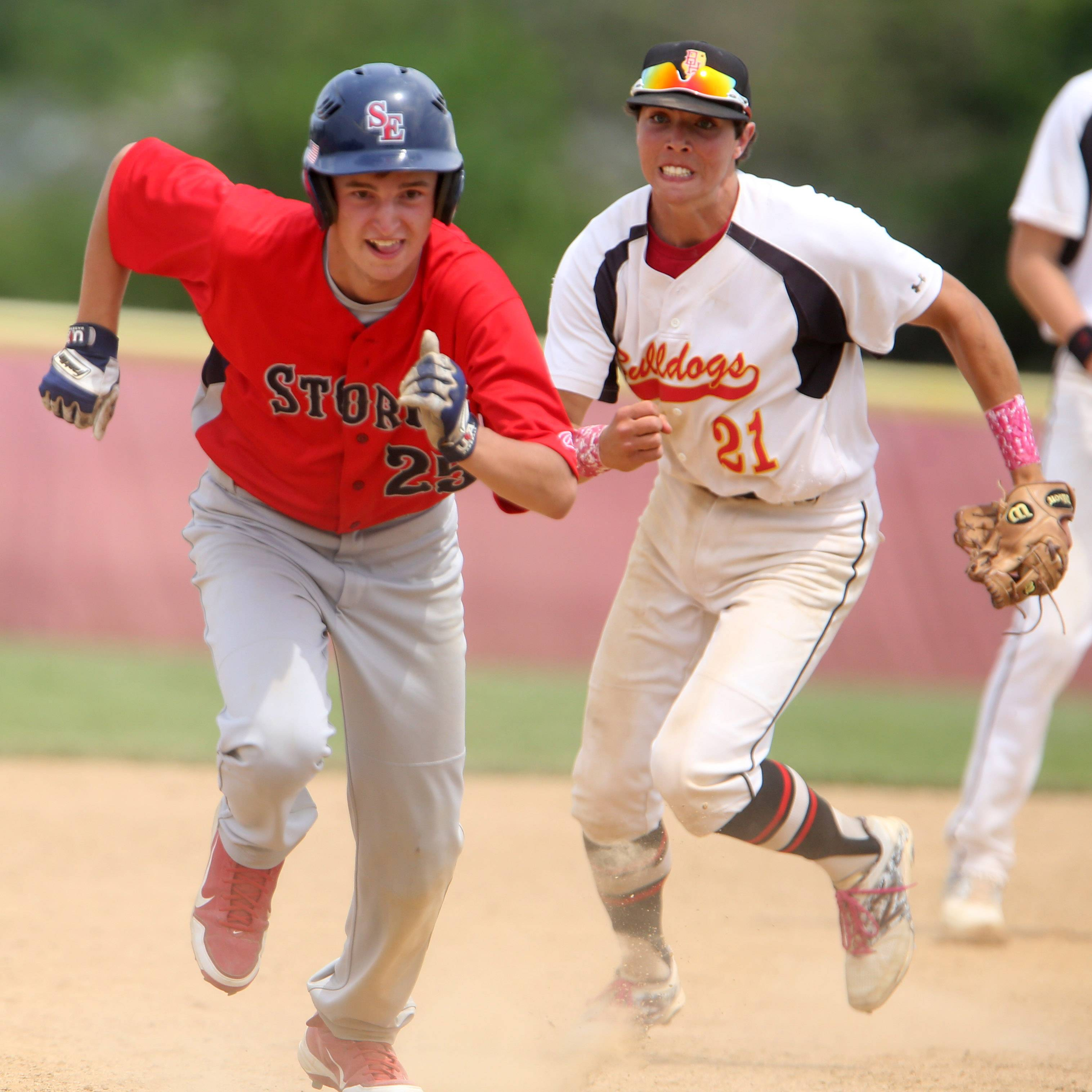 South Elgin's Kevin Barry is caught in a rundown and is chased by Batavia second baseman Jeremy Schoessling in Schaumburg sectional championship game Saturday.