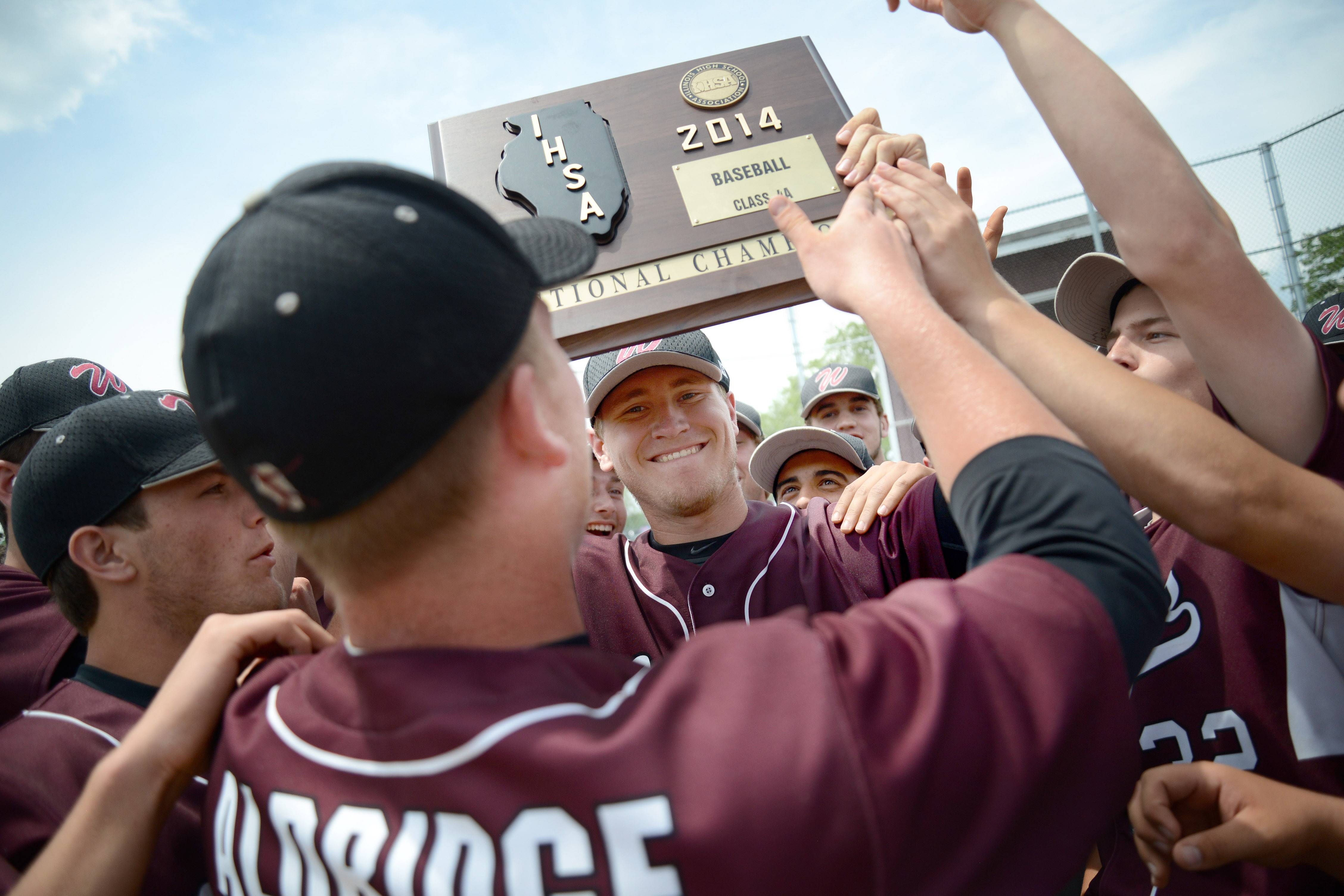 Prairie Ridge's Timothy Jablonsky (facing) and Caleb Aldridge (back to camera) hoist their Class 4A McHenry sectional championship plaque after defeating Jacobs at Peterson Park on Saturday.