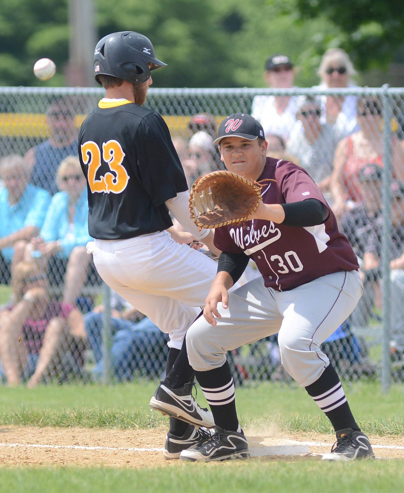 Jacobs' Ben Murray is safely back to first as Prairie Ridge's Marcus Sargeant takes the throw in the first inning of the Class 4A McHenry sectional championship game at Peterson Park on Saturday.