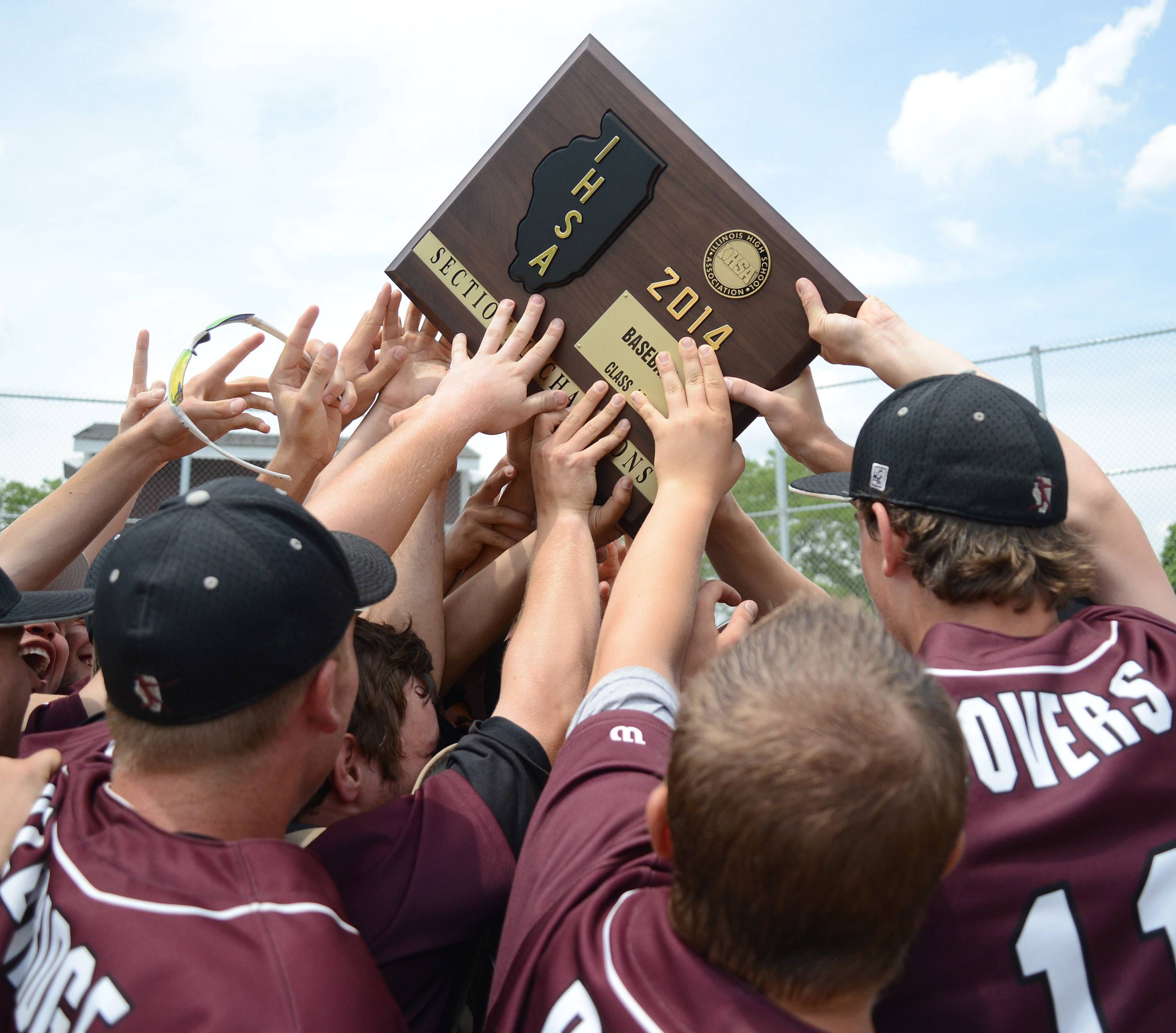 Prairie Ridge hoists up their plaque in celebration after winning the Class 4A McHenry sectional championship by topping Jacobs at Peterson Park Saturday.