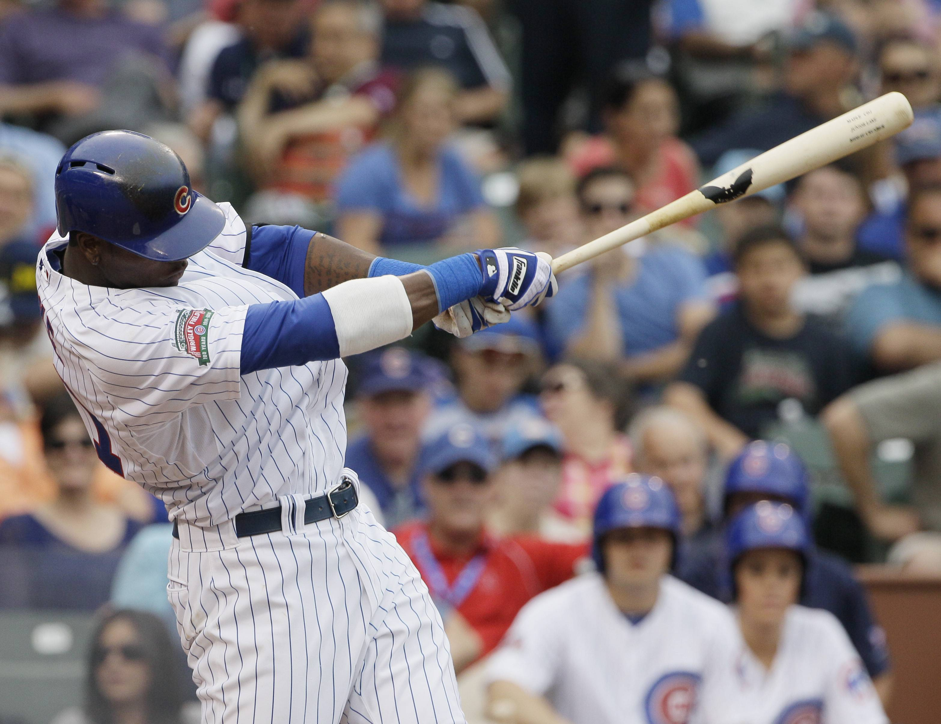 The Cubs' Junior Lake hits a solo home run during the fifth inning of a baseball game against the Miami Marlins in Chicago, Saturday, June 7, 2014.