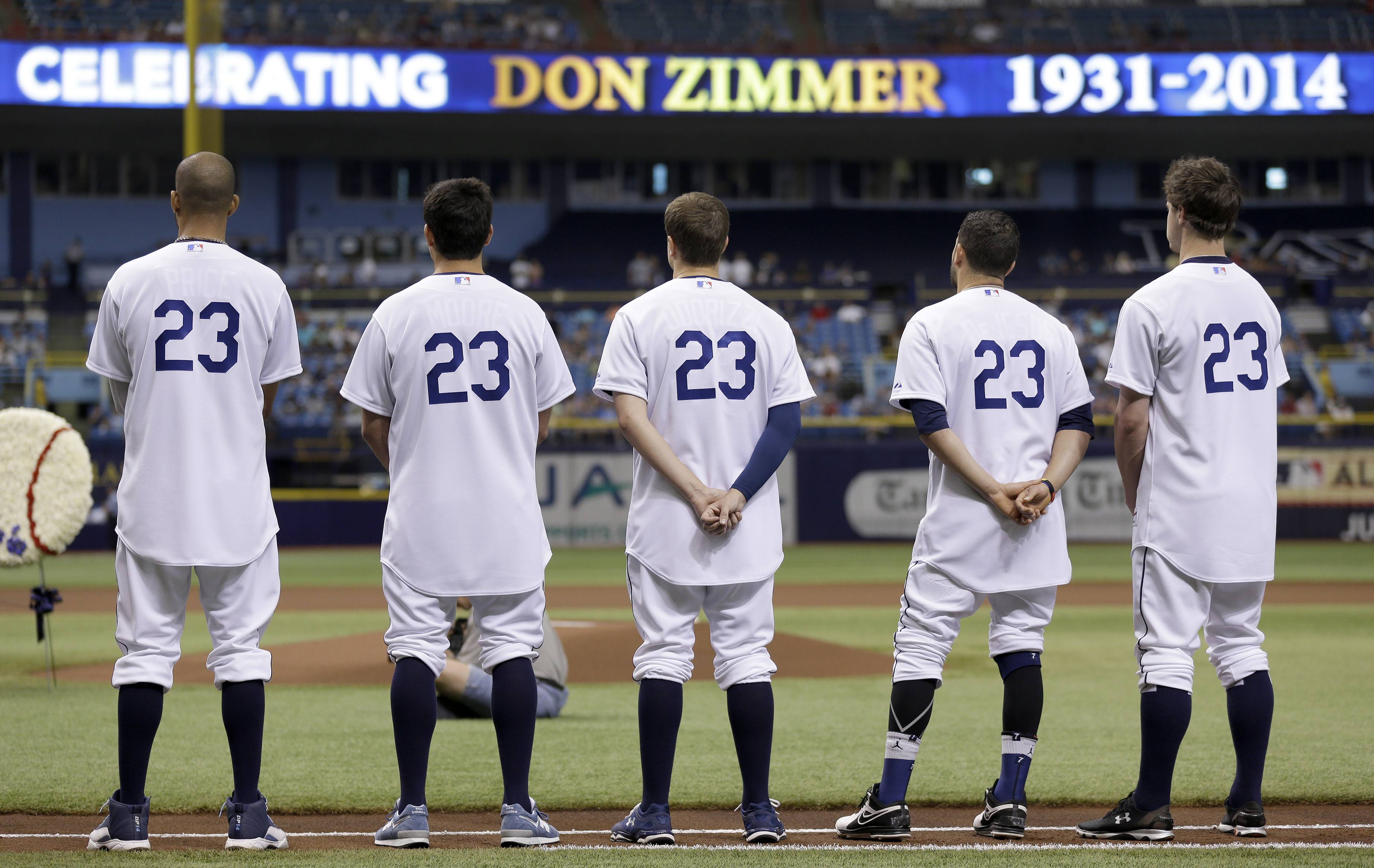 Members of the Tampa Bay Rays wear senior baseball adviser Don Zimmer replica Brooklyn Dodgers uniforms before a baseball game Saturday, June 7, 2014, in St. Petersburg, Fla. Zimmer passed away earlier this week at the age of 83.
