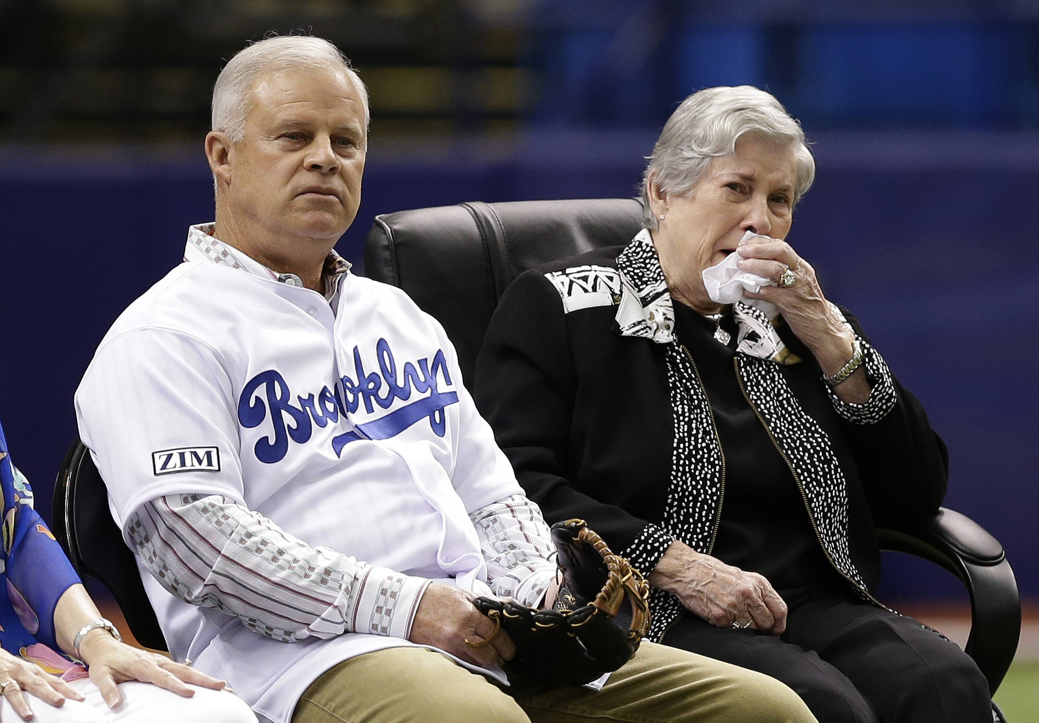 Don Zimmer's wife Soot, right, and son Tom watch a video tribe to Rays senior baseball adviser Don Zimmer before a baseball game Saturday, June 7, 2014, in St. Petersburg, Fla. Don Zimmer passed way earlier this week at the age of 83.
