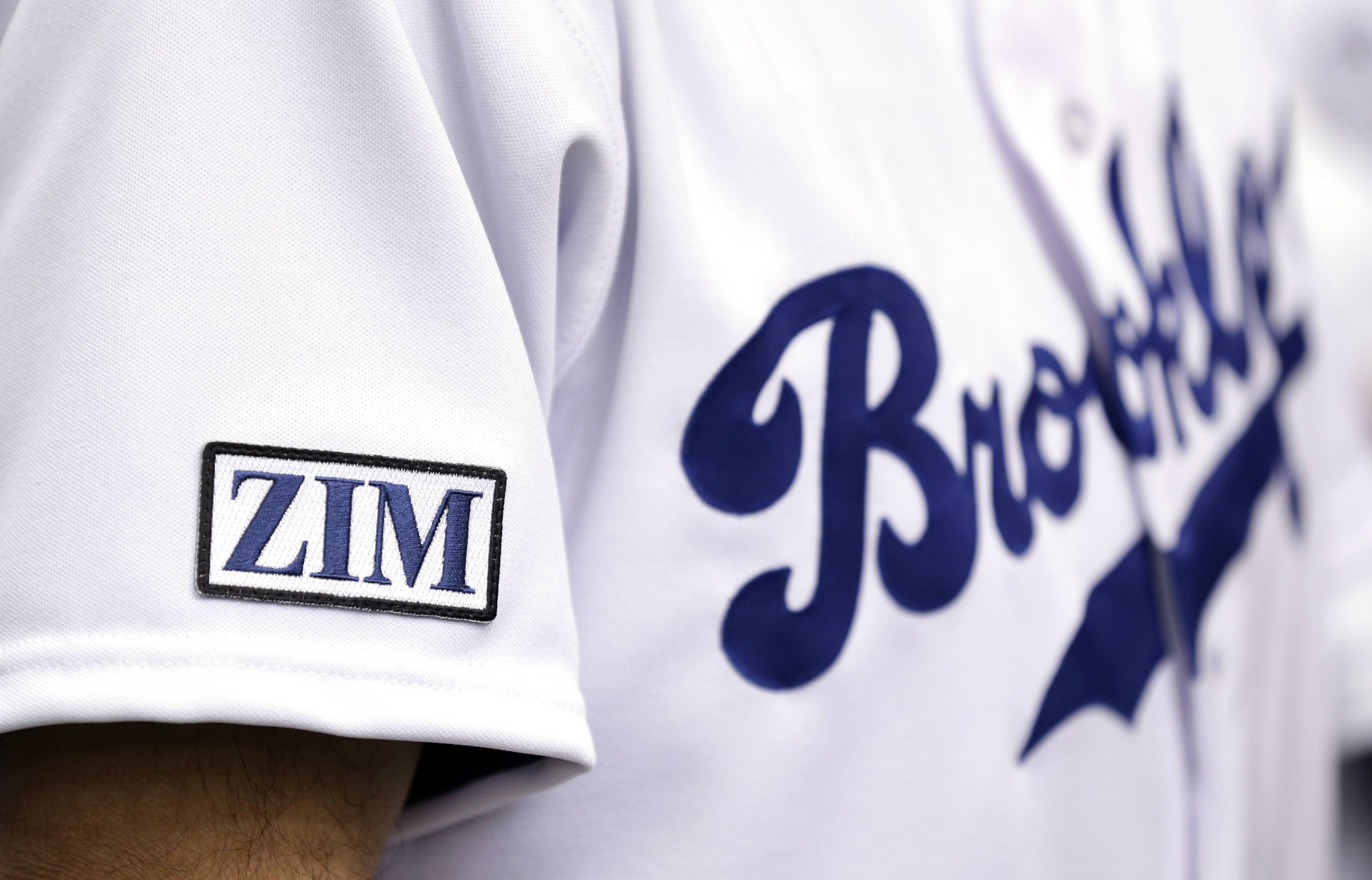 Tampa Bay Rays players wear a Brooklyn Dodgers replica jersey and patch honoring senior baseball adviser Don Zimmer before a baseball game against the Seattle Mariners Saturday, June 7, 2014, in St. Petersburg, Fla. Zimmer passed away earlier this week at the age of 83.