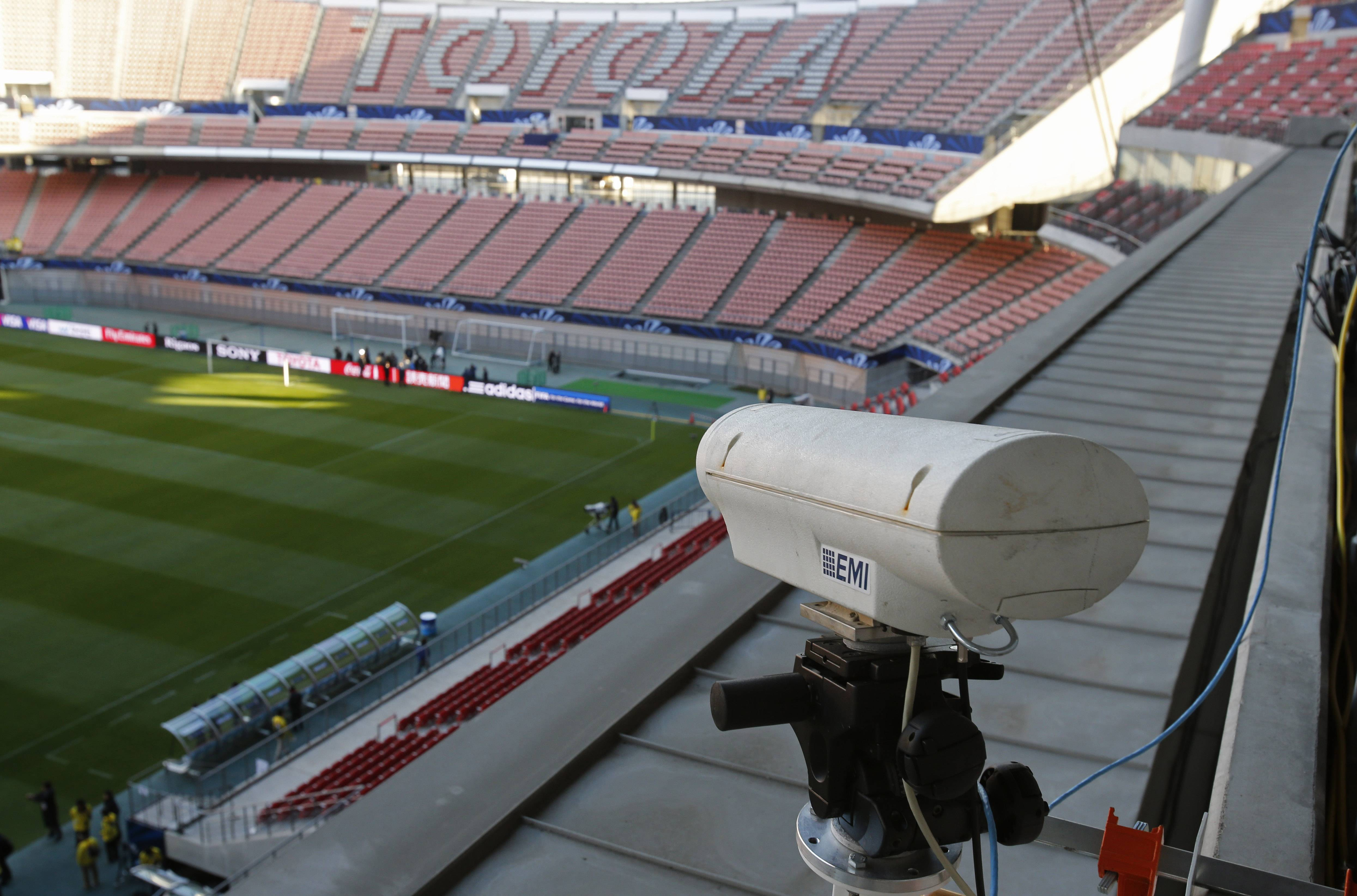 In this Saturday, Dec. 8, 2012, file photo, a Hawk-Eye camera is set up at Toyota stadium in Toyota. For the first time at a World Cup, technology will be used to determine whether a ball crosses the goal line during matches at the upcoming tournament in Brazil. With vanishing spray also being used to prevent encroachment by defenders making up a wall during free kicks, officials at the highest level of the world's most popular sport are finally getting some assistance.