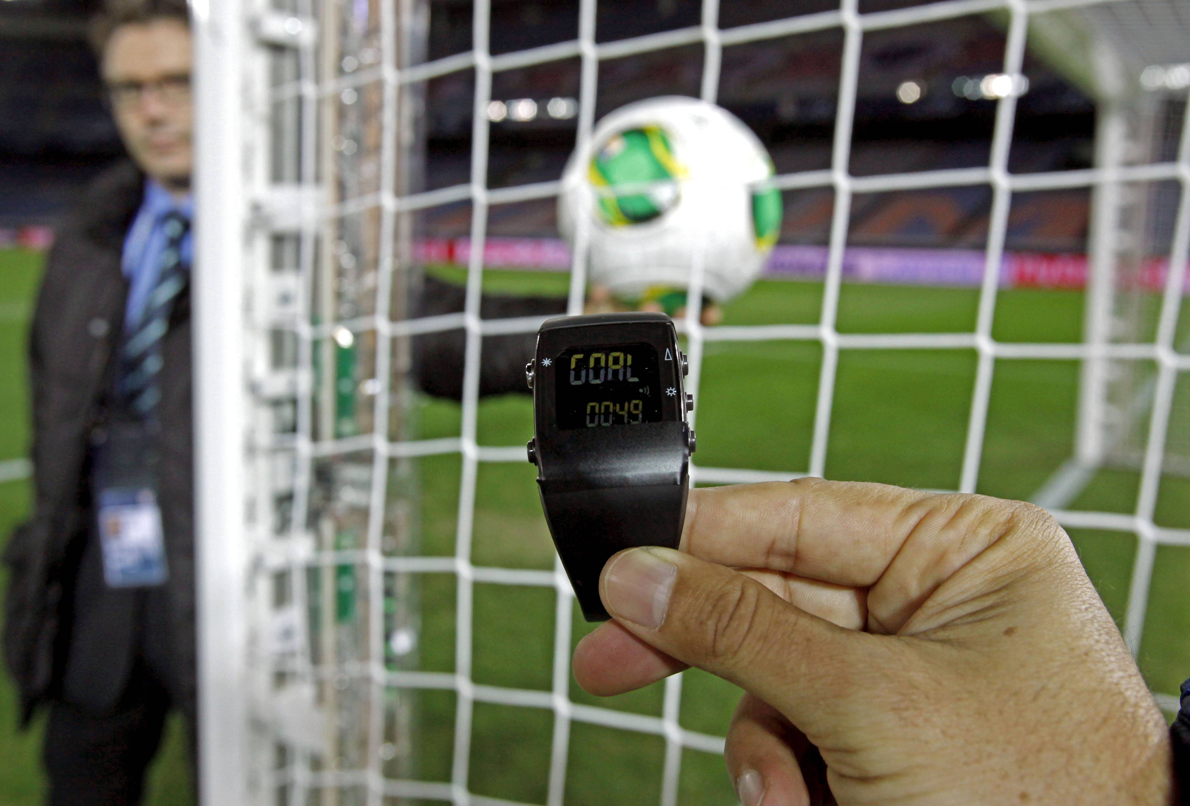 In this Wednesday, Dec. 5, 2012, file photo, the goal-line monitoring device is demonstrated before the media at Yokohama Stadium in Yokohama, near Tokyo. For the first time at a World Cup, technology will be used to determine whether a ball crosses the goal line during matches at the upcoming tournament in Brazil. With vanishing spray also being used to prevent encroachment by defenders making up a wall during free kicks, officials at the highest level of the world's most popular sport are finally getting some assistance.