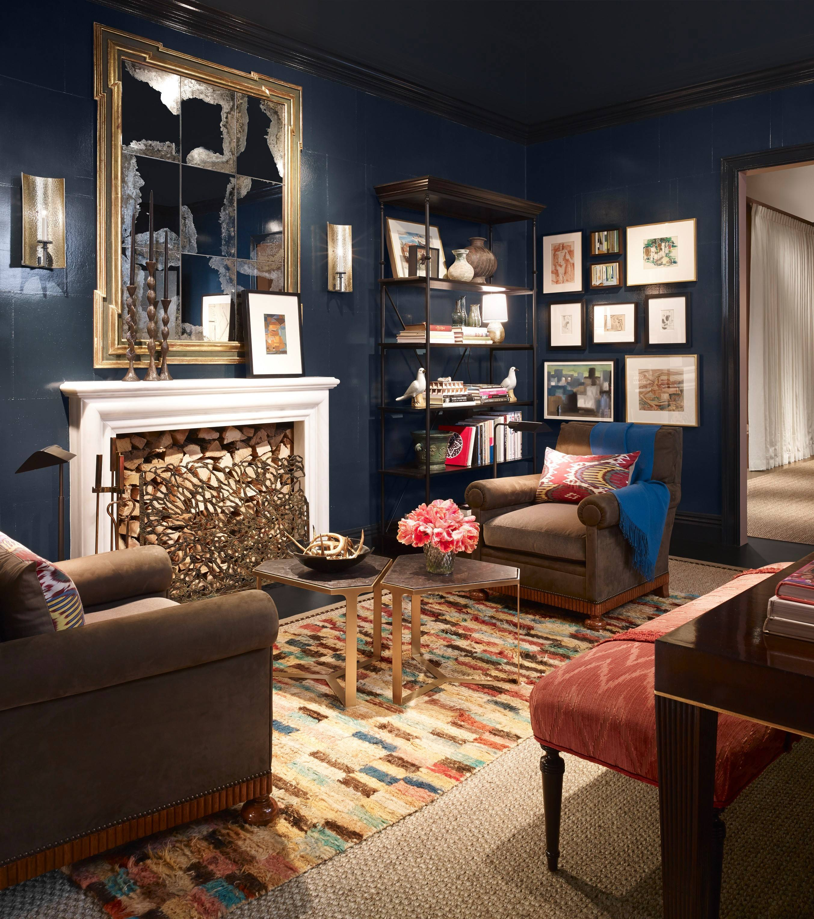 In the study by Jessica Lagrange, the walls are a dark, smokey Hague Blue from Farrow & Ball.